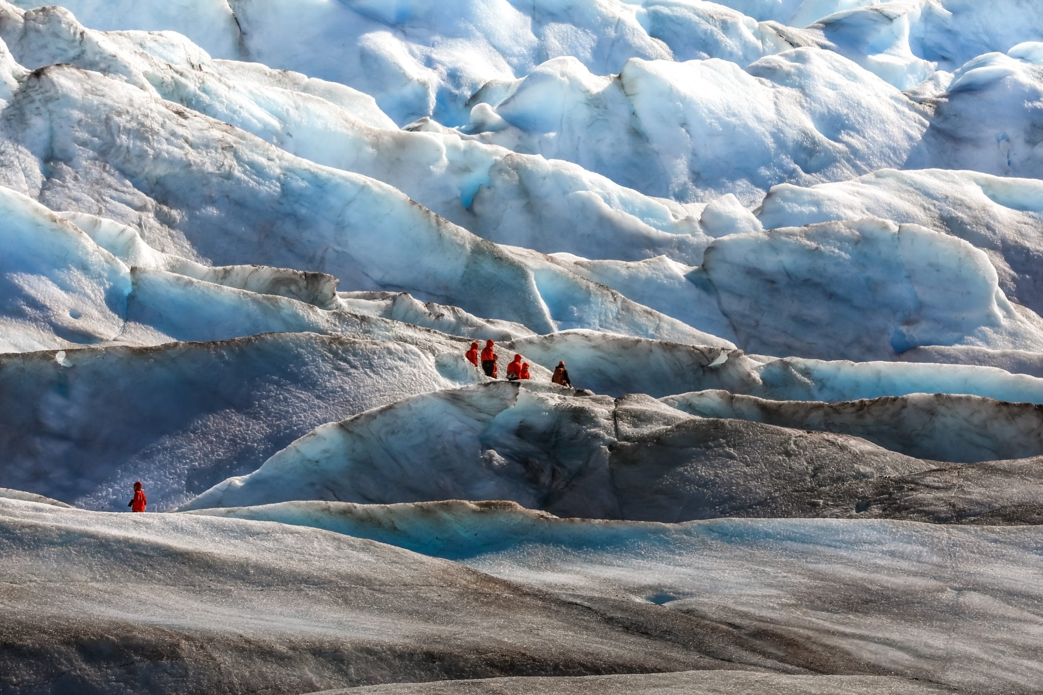Hikers on a glacier by Martina Birnbaum