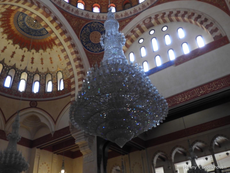 chandelier in the mosque  by Henny van Broekhoven