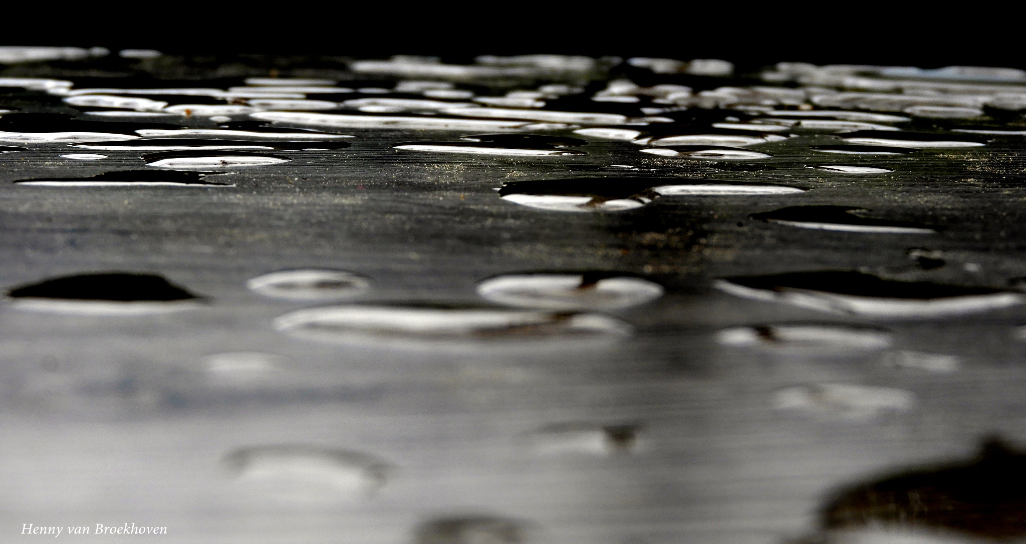 raindrops on the table by Henny van Broekhoven