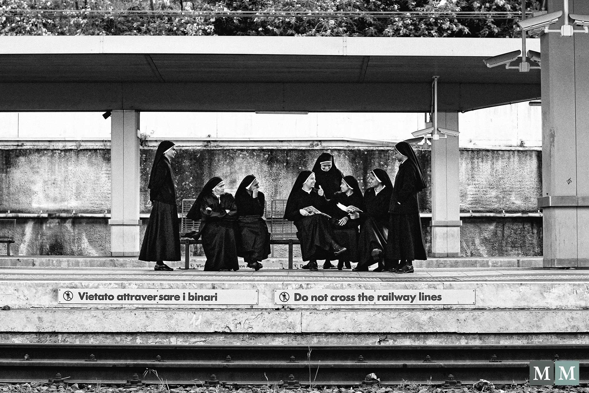 Sisters waiting on a train station in Rome by meszarovits
