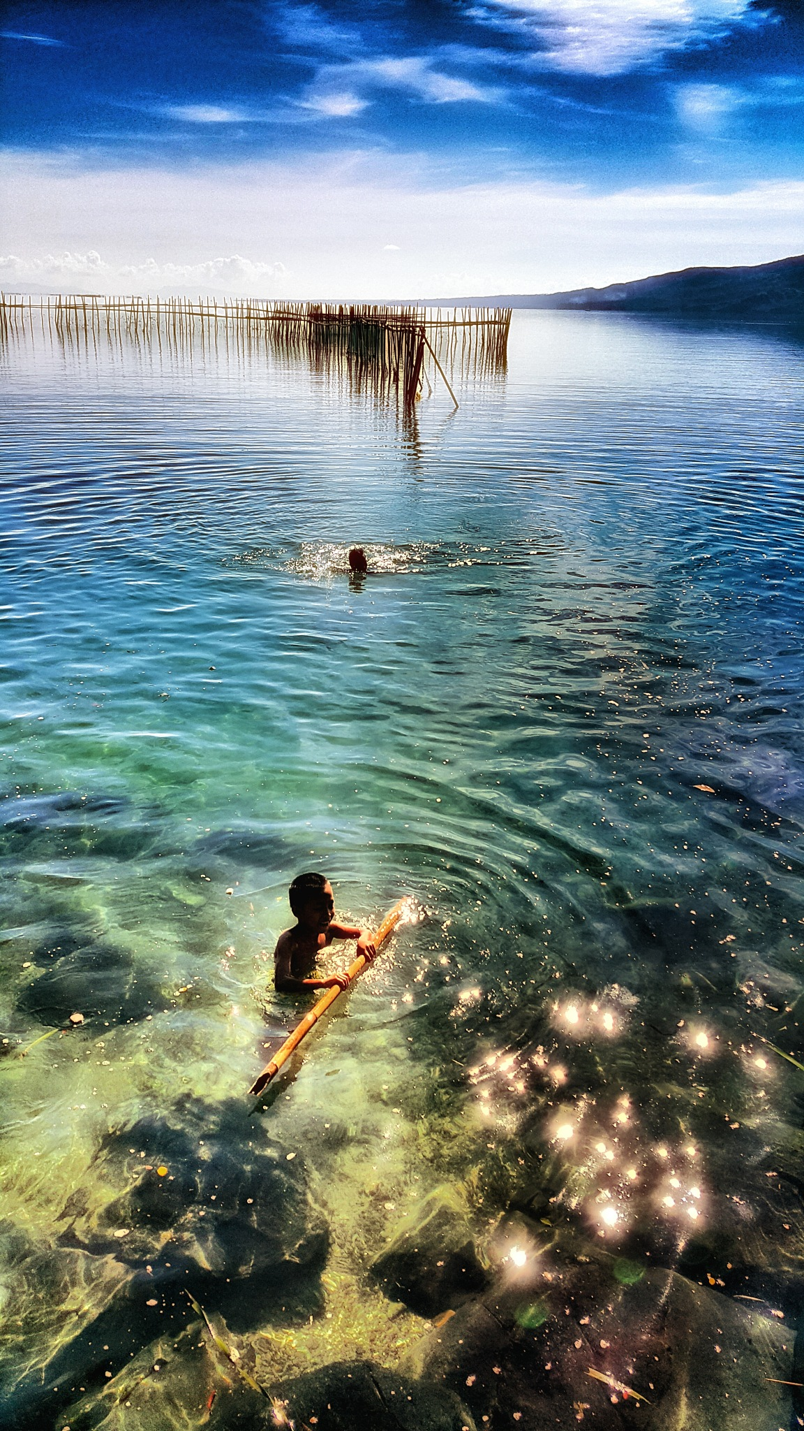 The waters of Bagacay by Natz M. Alcera