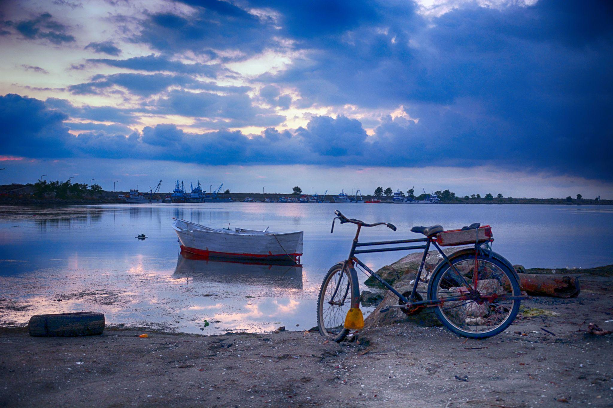 Blue and Bicycle by Hakan Leblebicioglu