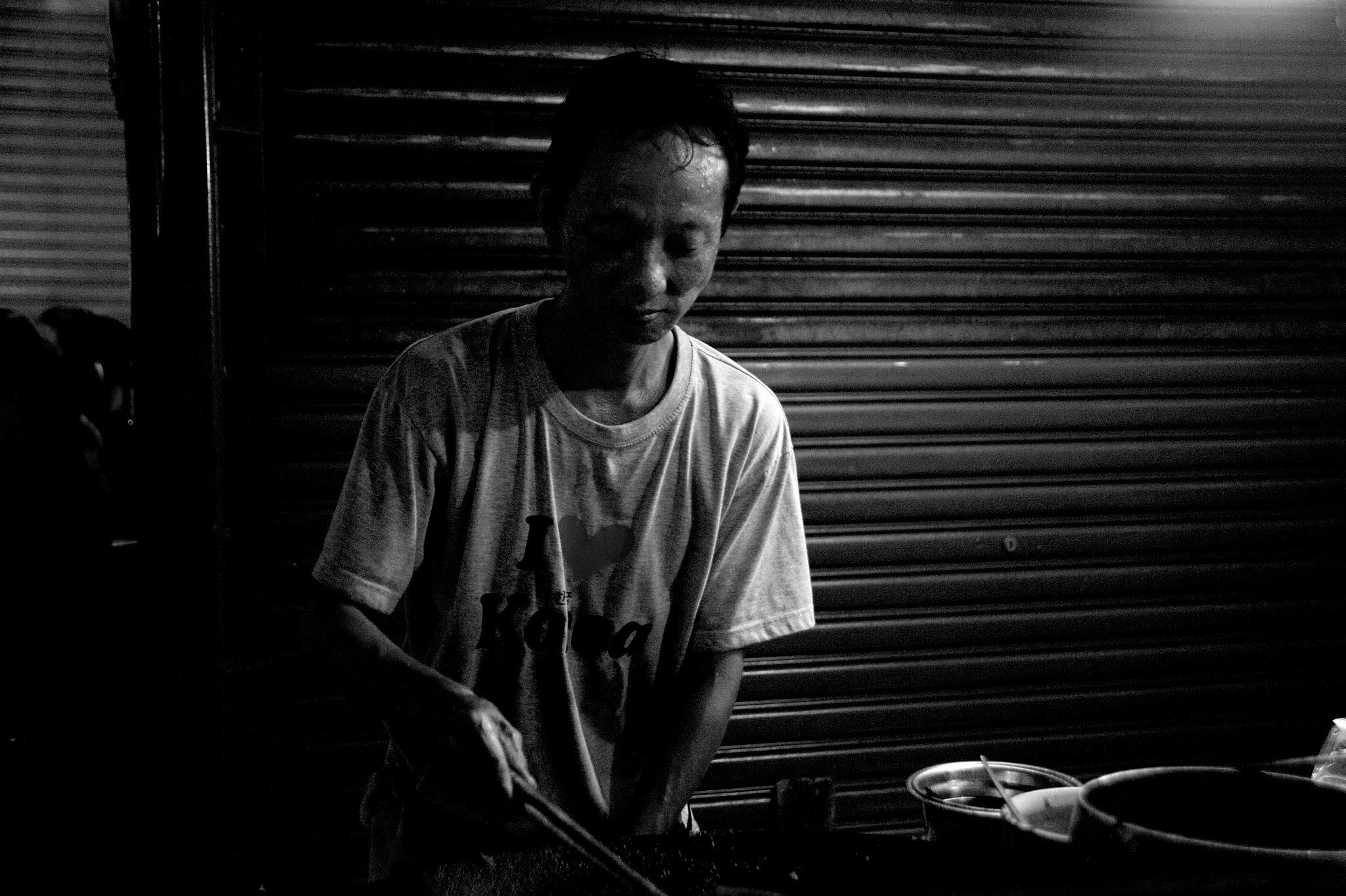 portraits of a hawker  by Mustaffa Tapa Otai