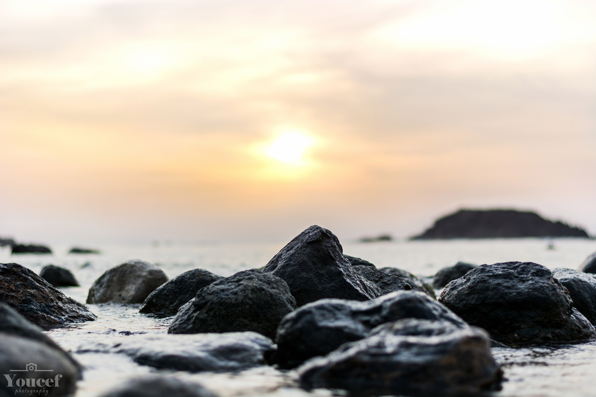 Sun behaind the rocks  by Youcef Abdou