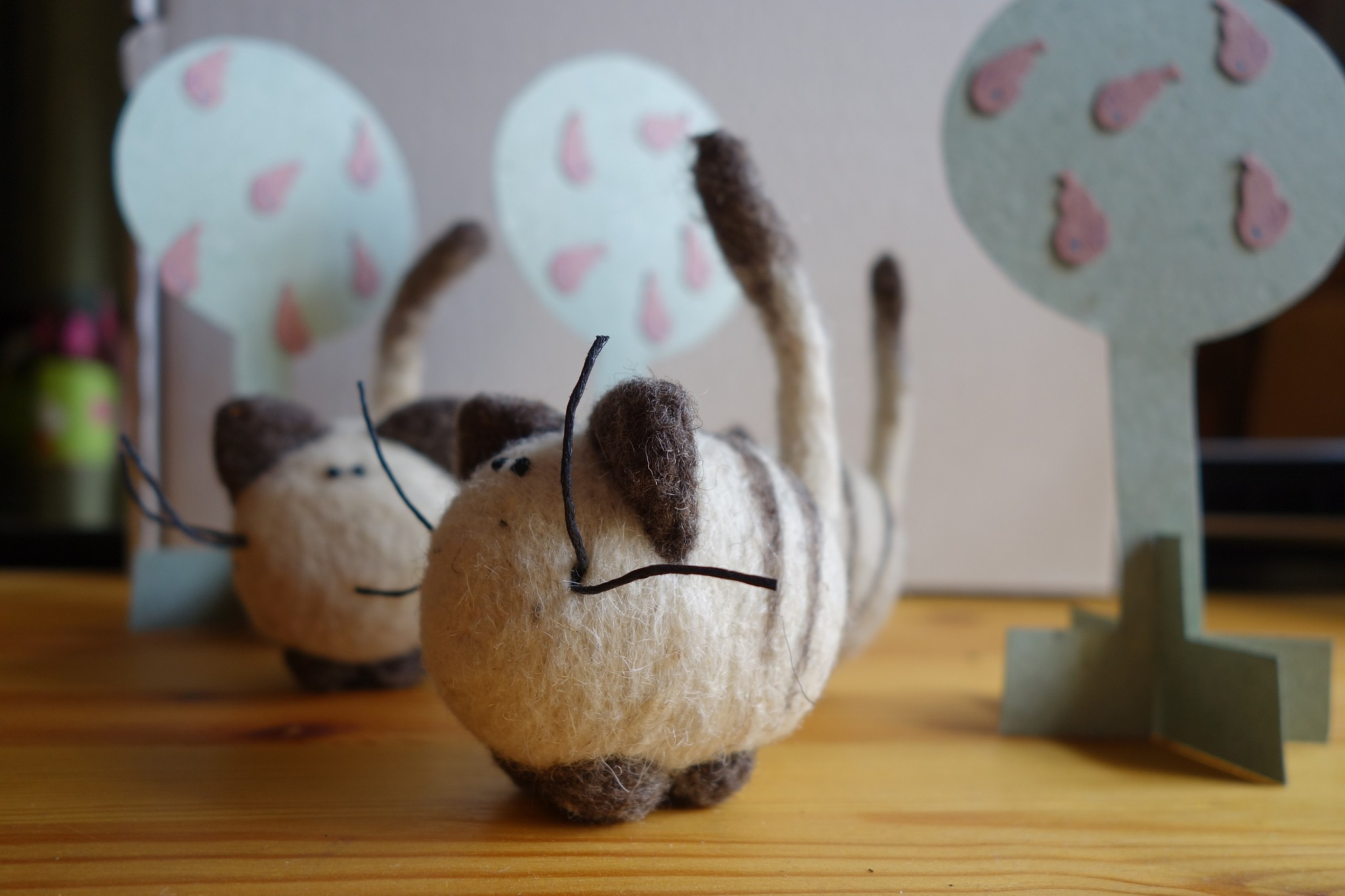 The woolen cats Roonya are walking among pears by Roonya