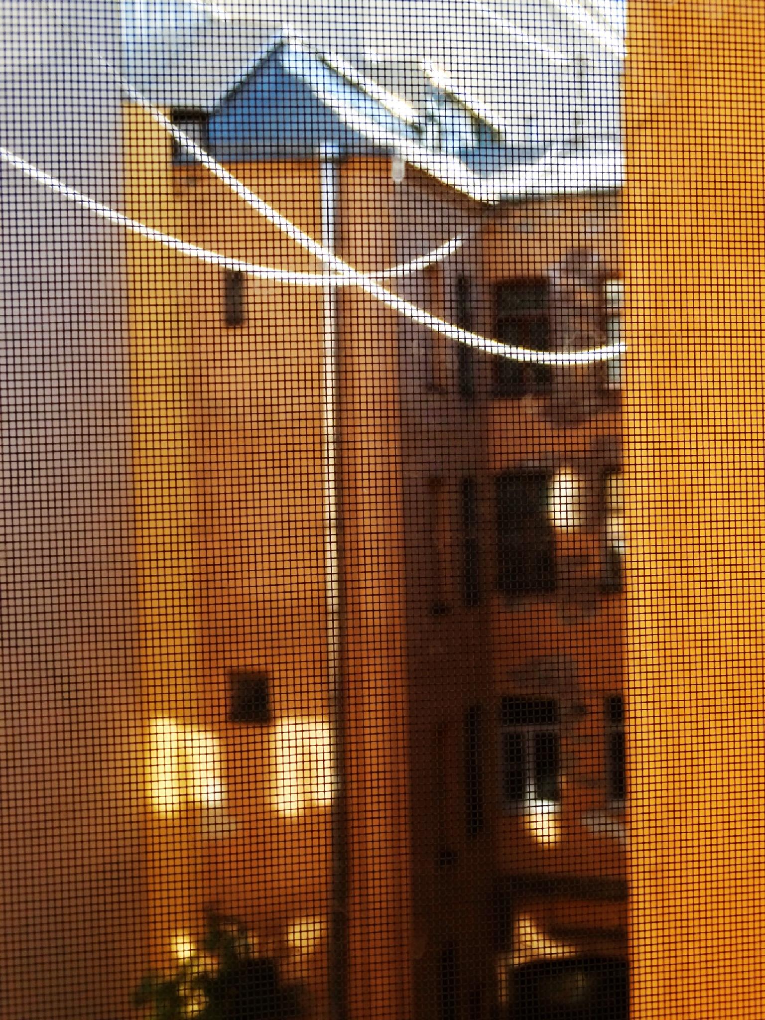 Вид из окна на солнечный дворик by tarutinaolga2012