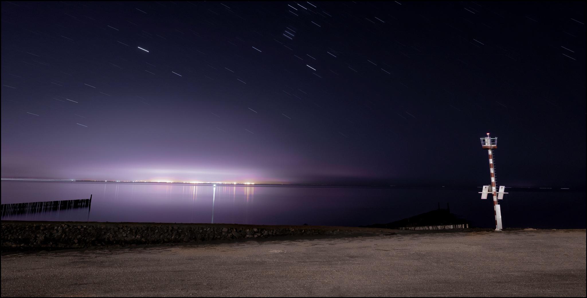 Photo in Random #sea #beach #sand #coast #holland #netherlands #expose #purple sky #putple #tranquillity #long exposure #exposer #distance #location #lighthouse #nikon #nikonphotography