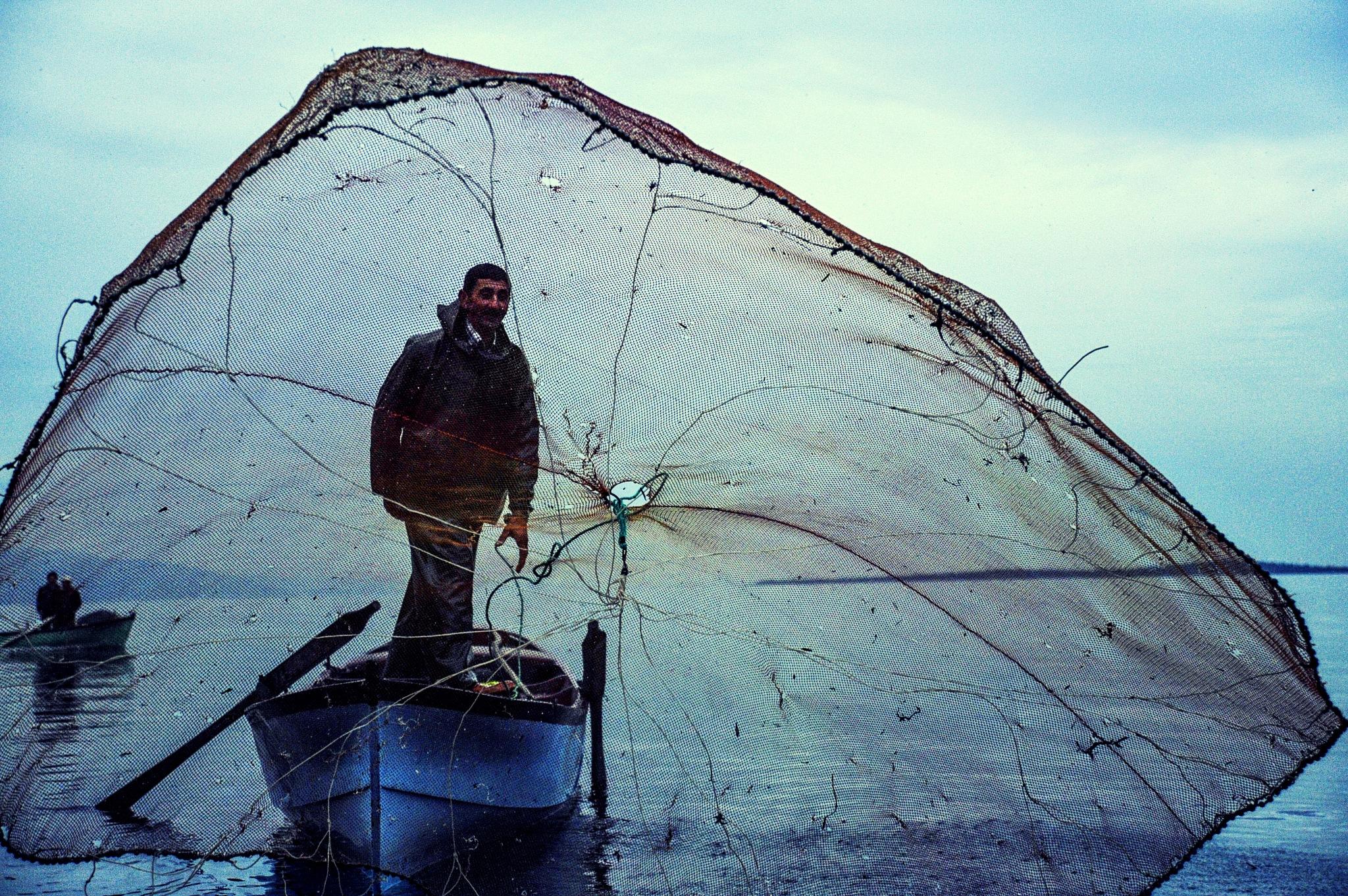fisherman and his net by Muhsin Özcan