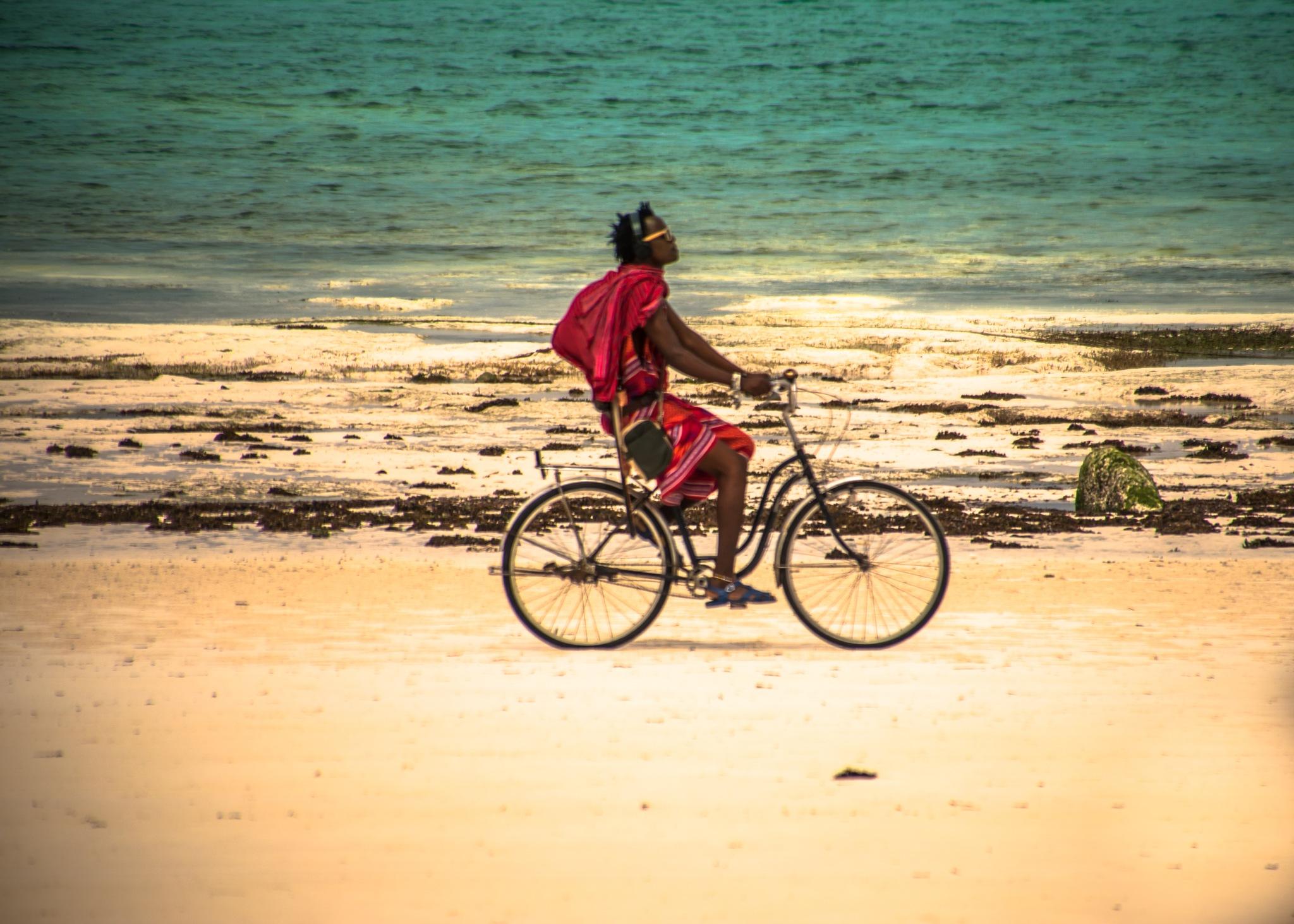 the modern massai goes by bike by Guido Braeuer