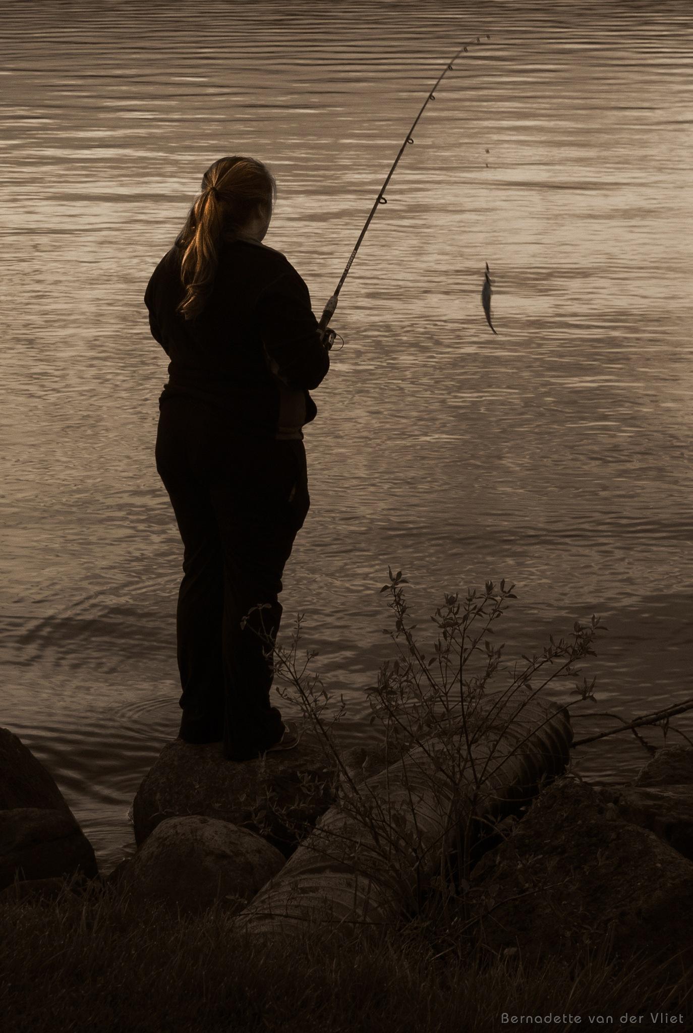 Girl fishing by Bernadette van der Vliet