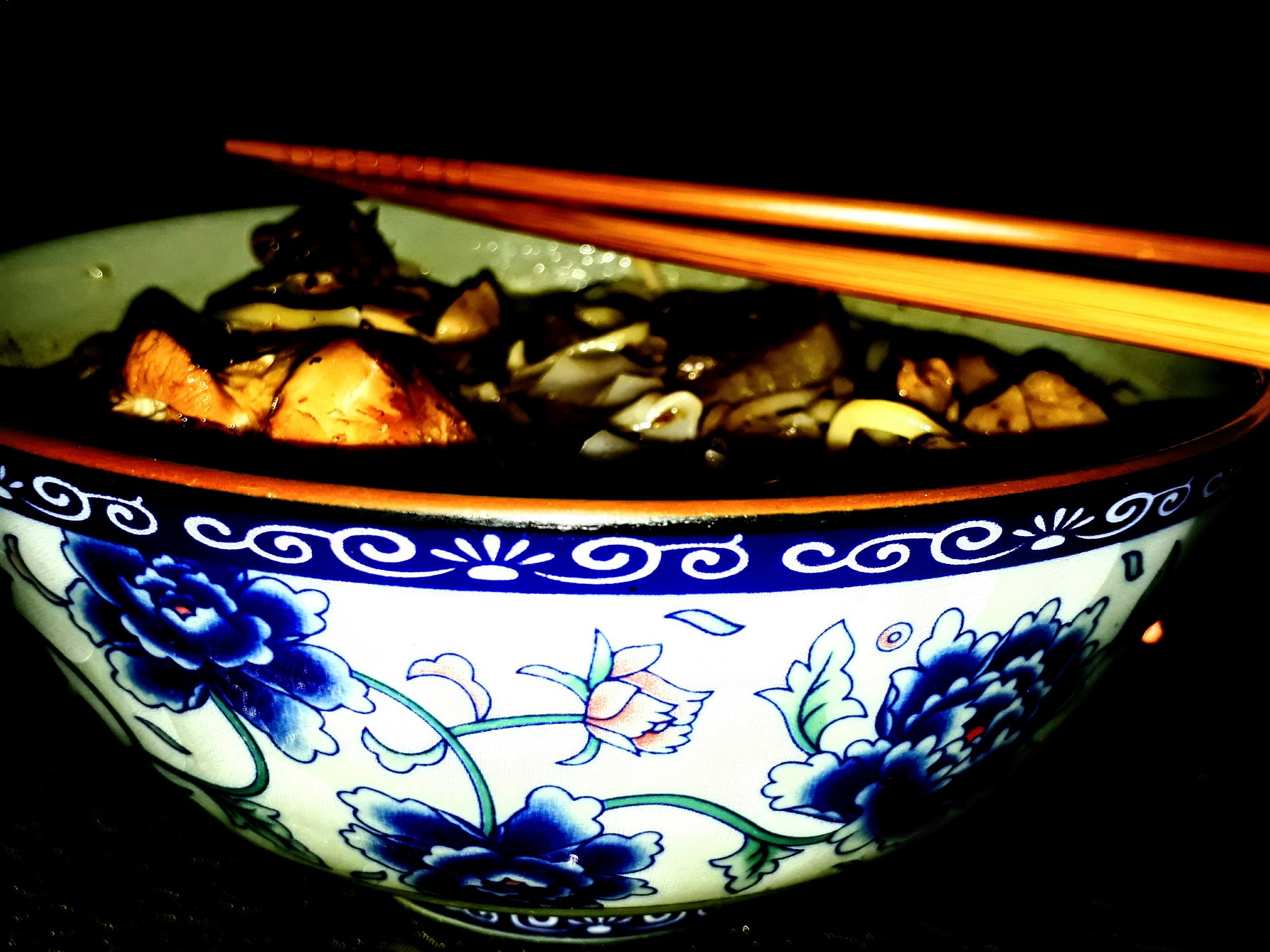Enjoying a bowl of authentic taste of Thai Chicken Noodle.. by Gary Yap