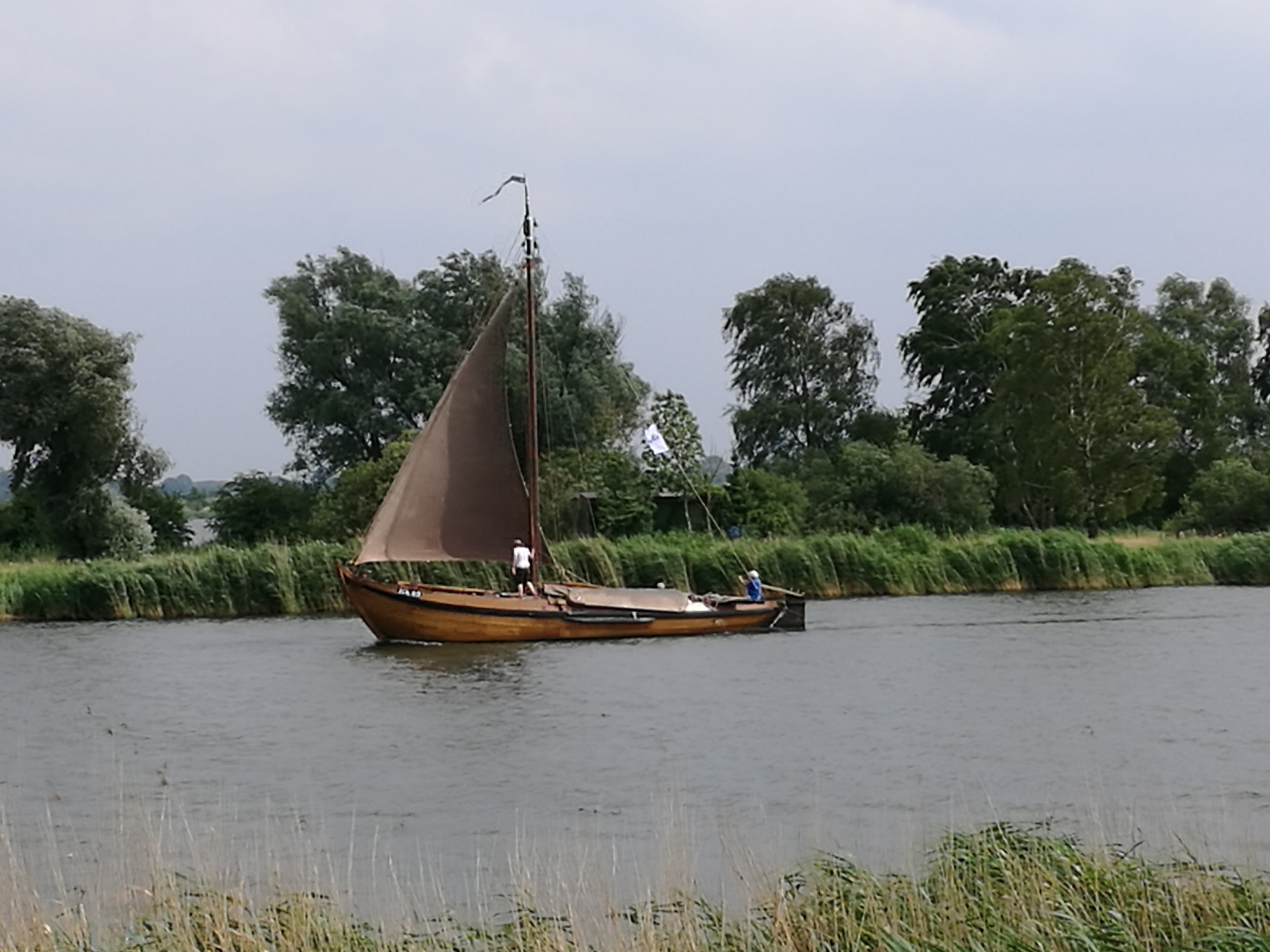a botter sailing on the Veluwe meer in the Netherlands  by Edo Snippe