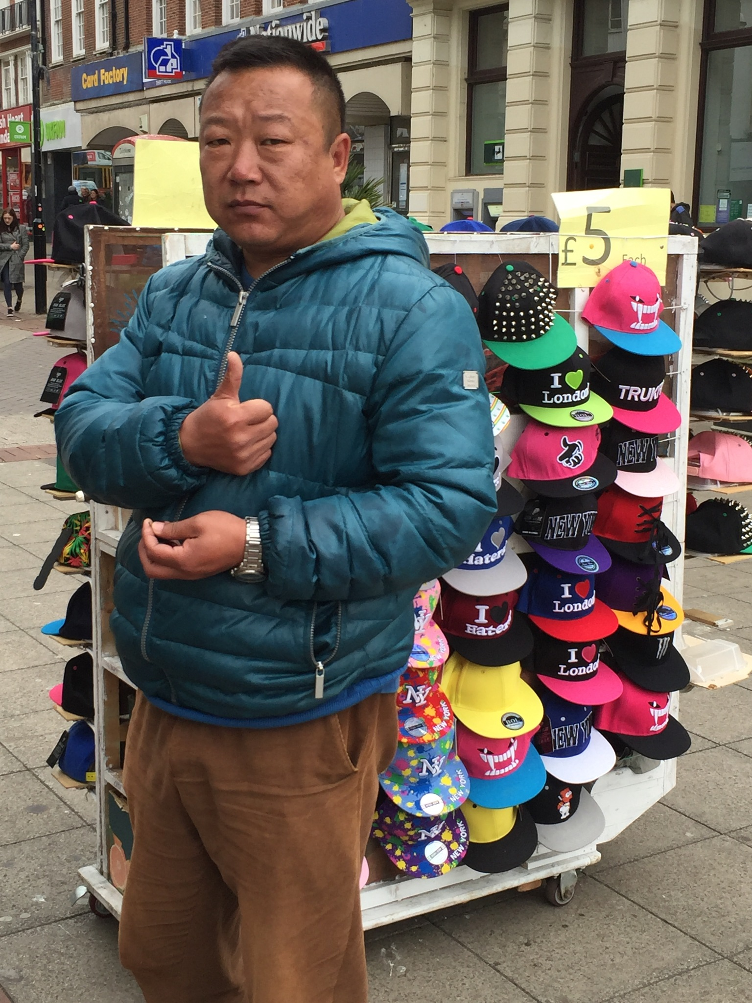 Chinese man selling hats  by KurdSpring