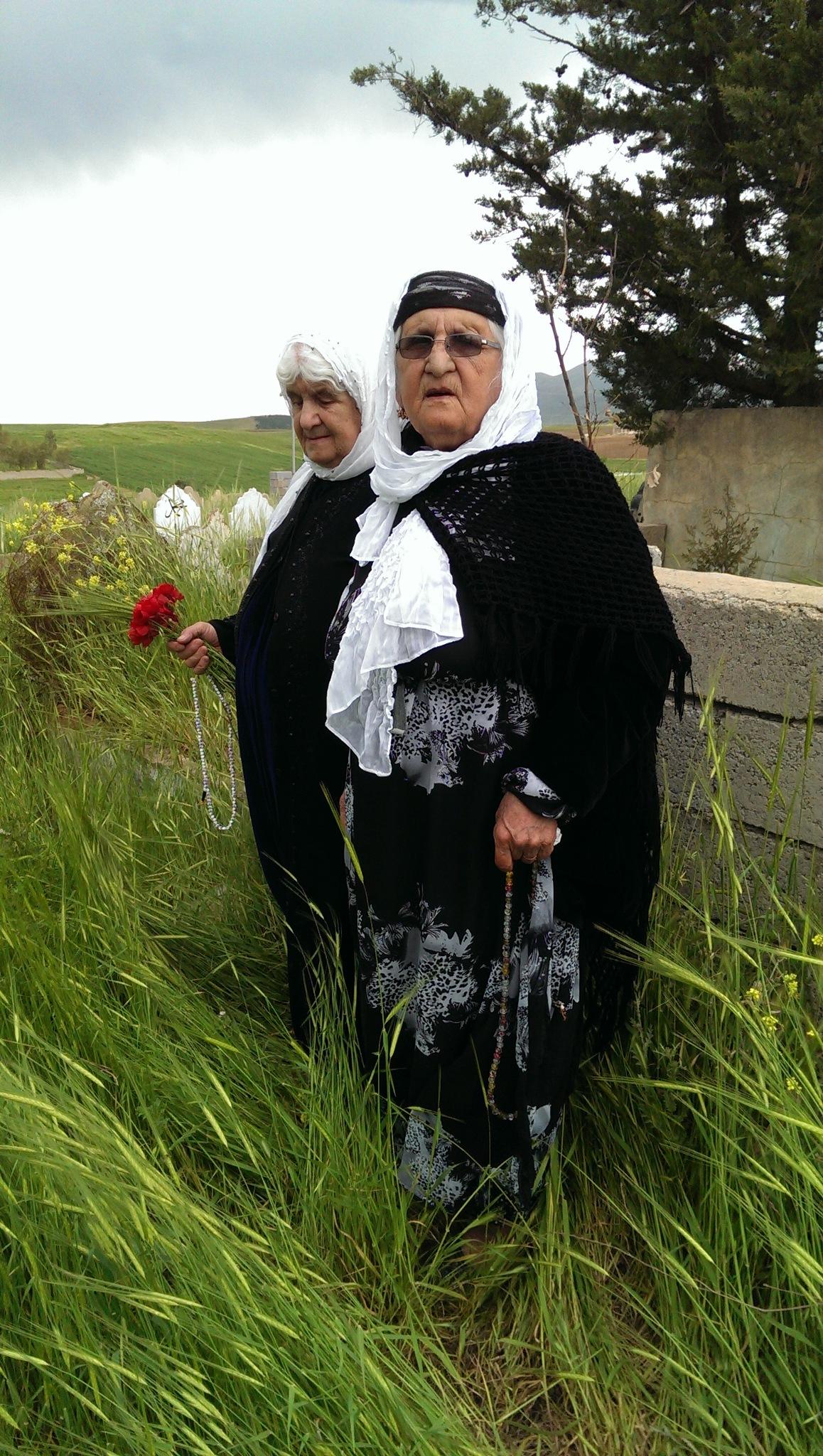 2 beautiful Kurdish women on her brothers grave by Karzan Jaff