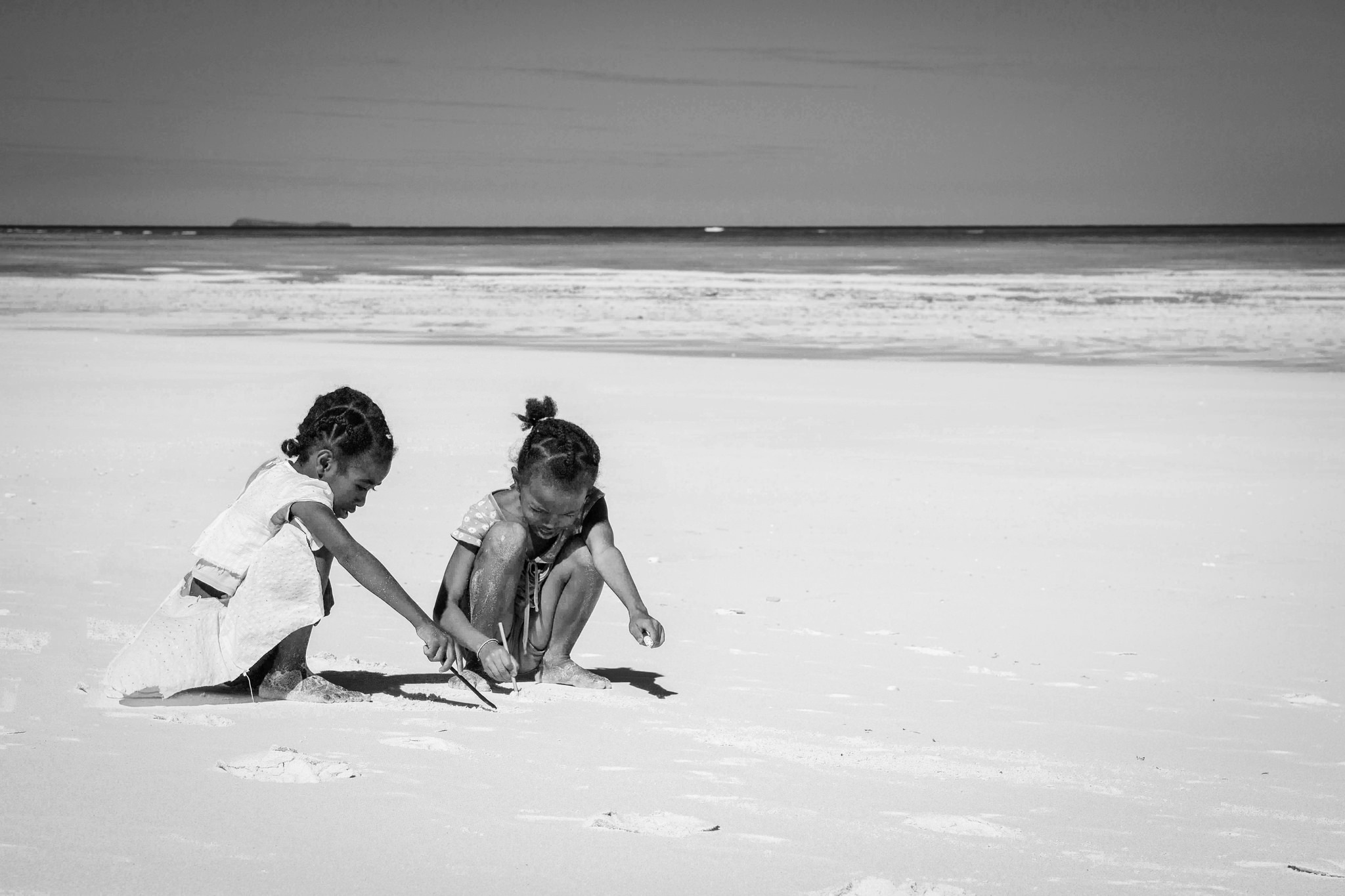 playing on the sand by Maurizio Battiston