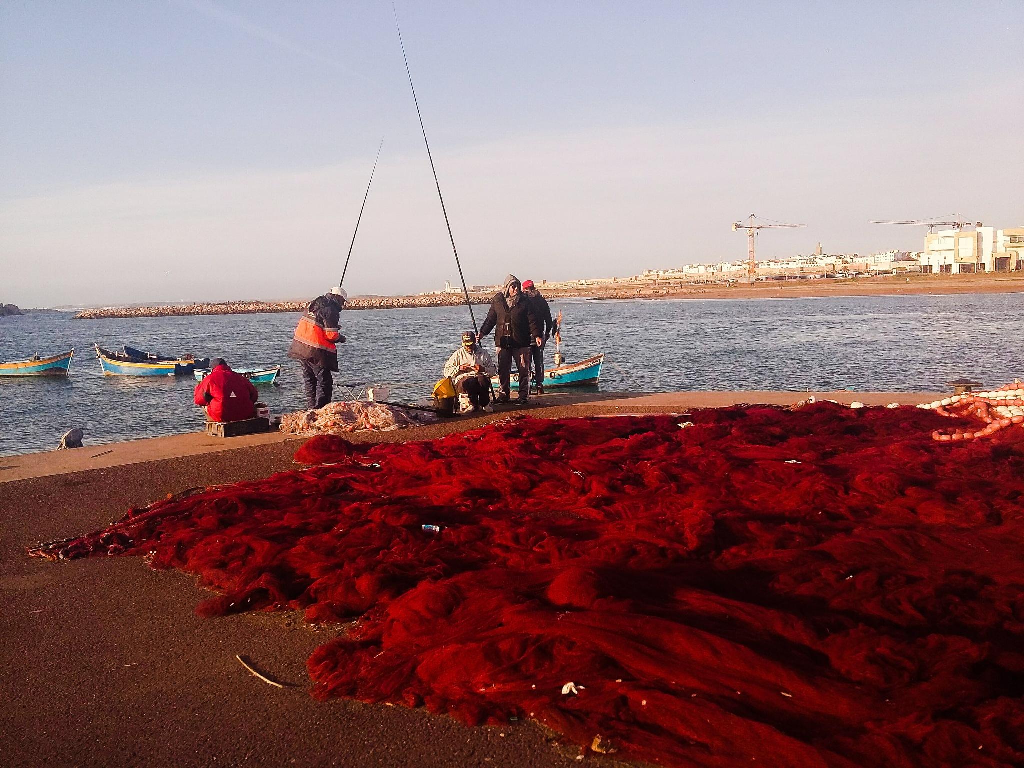 fisherman by Abdellah Ait Othman