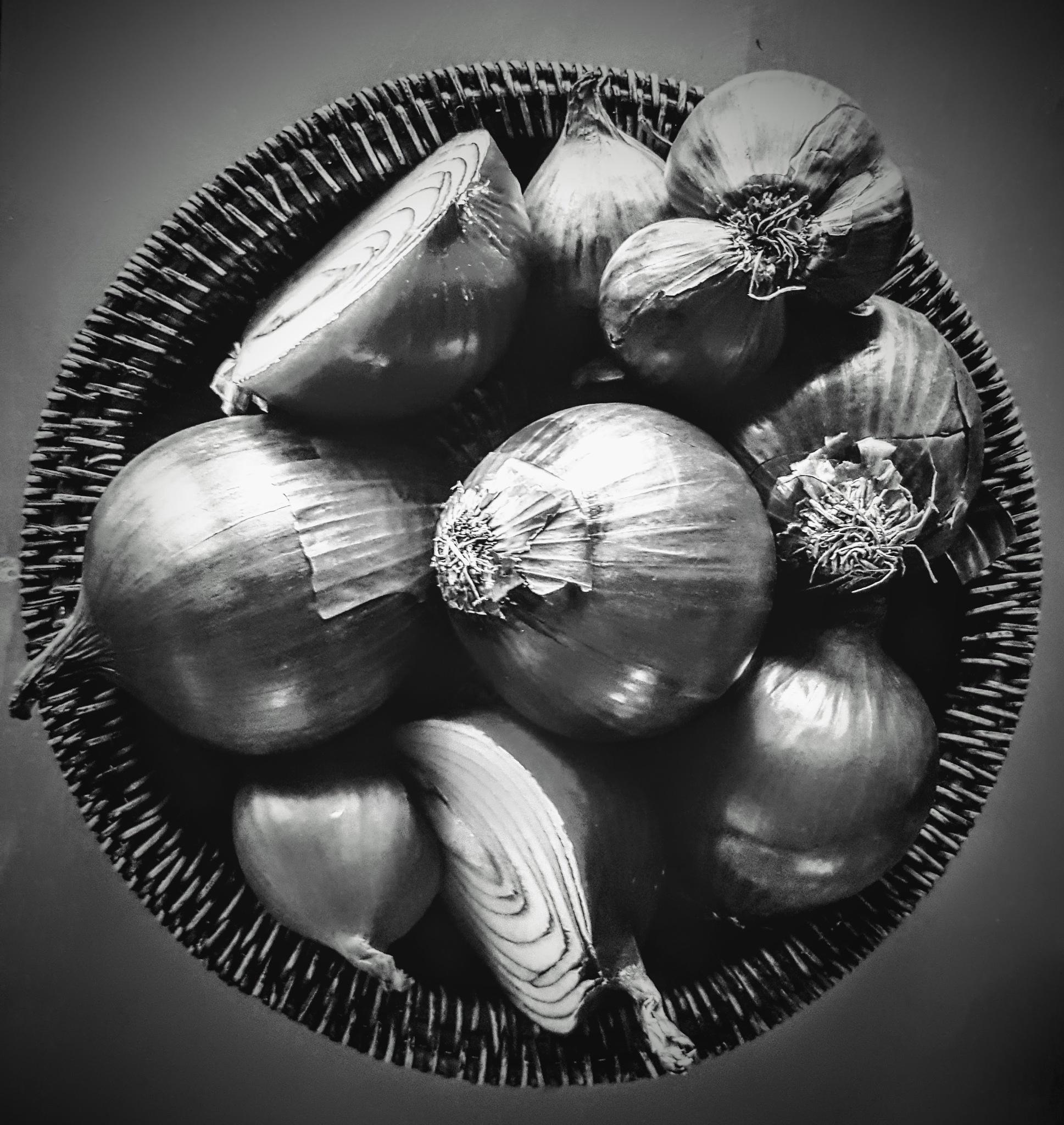 Basket of onions by Amanda Savage
