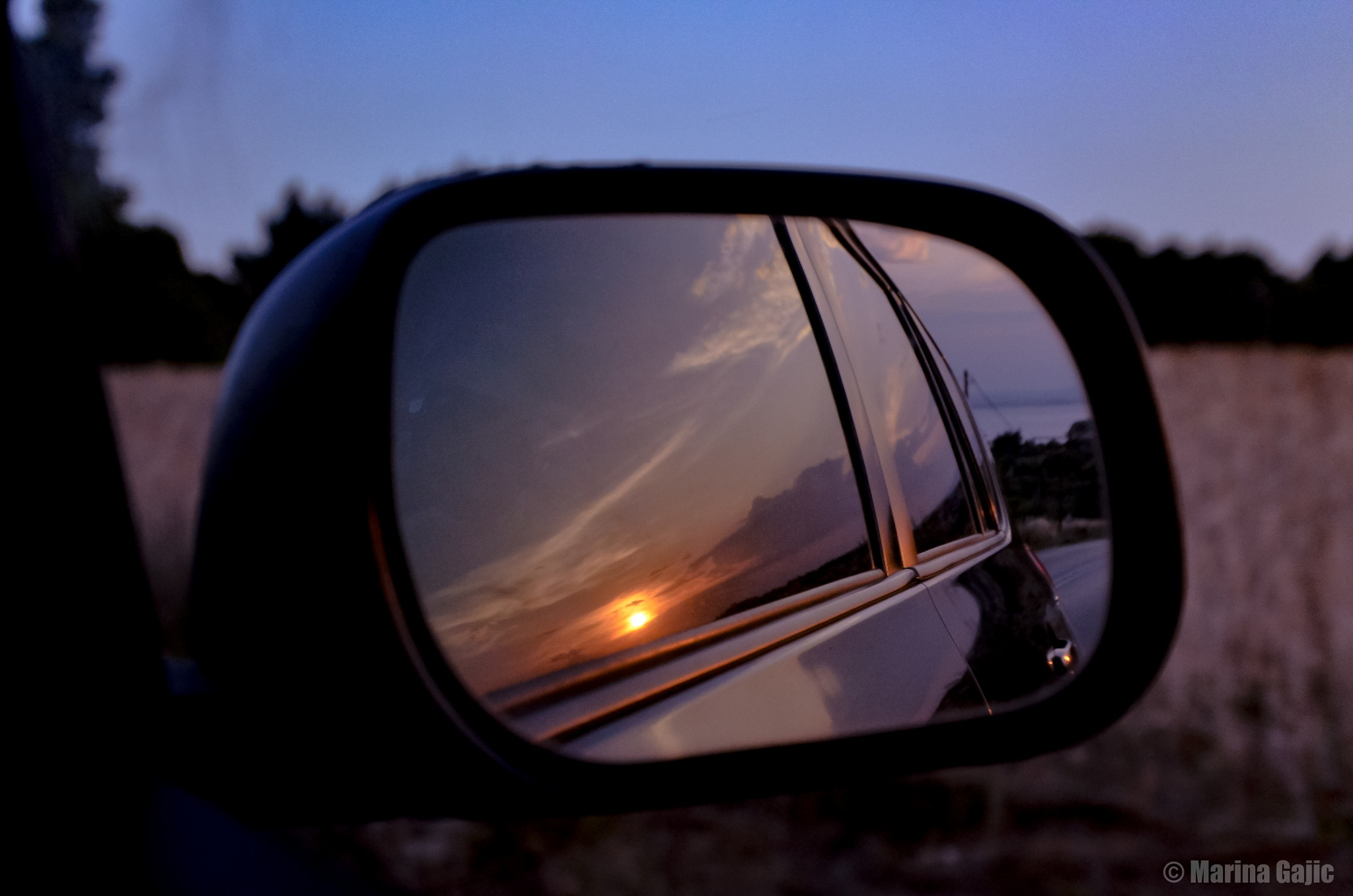 Sunset from car by Marina Gajic