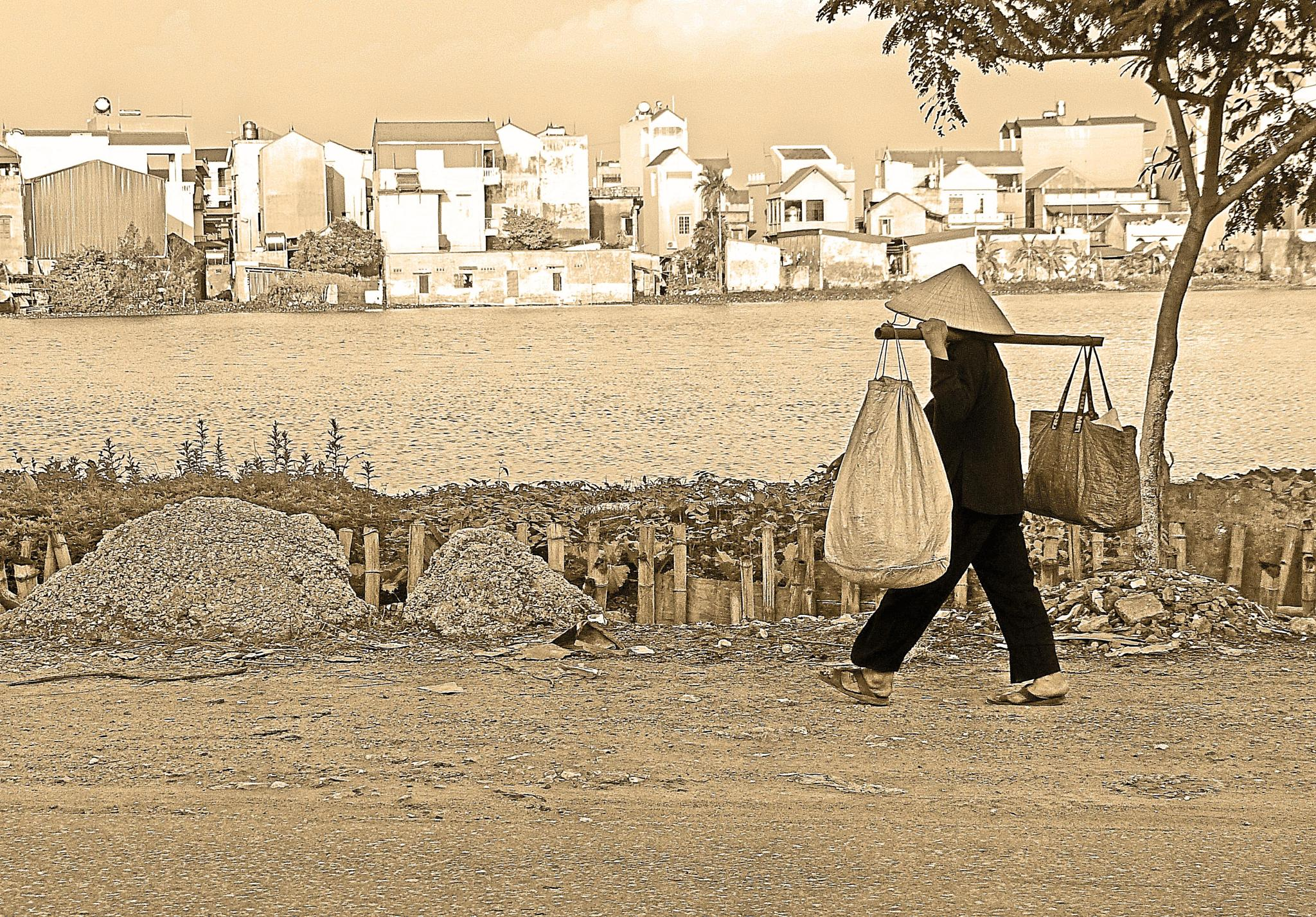 Photo in Street Photography #hanoi #vietnam #street #woman #walking