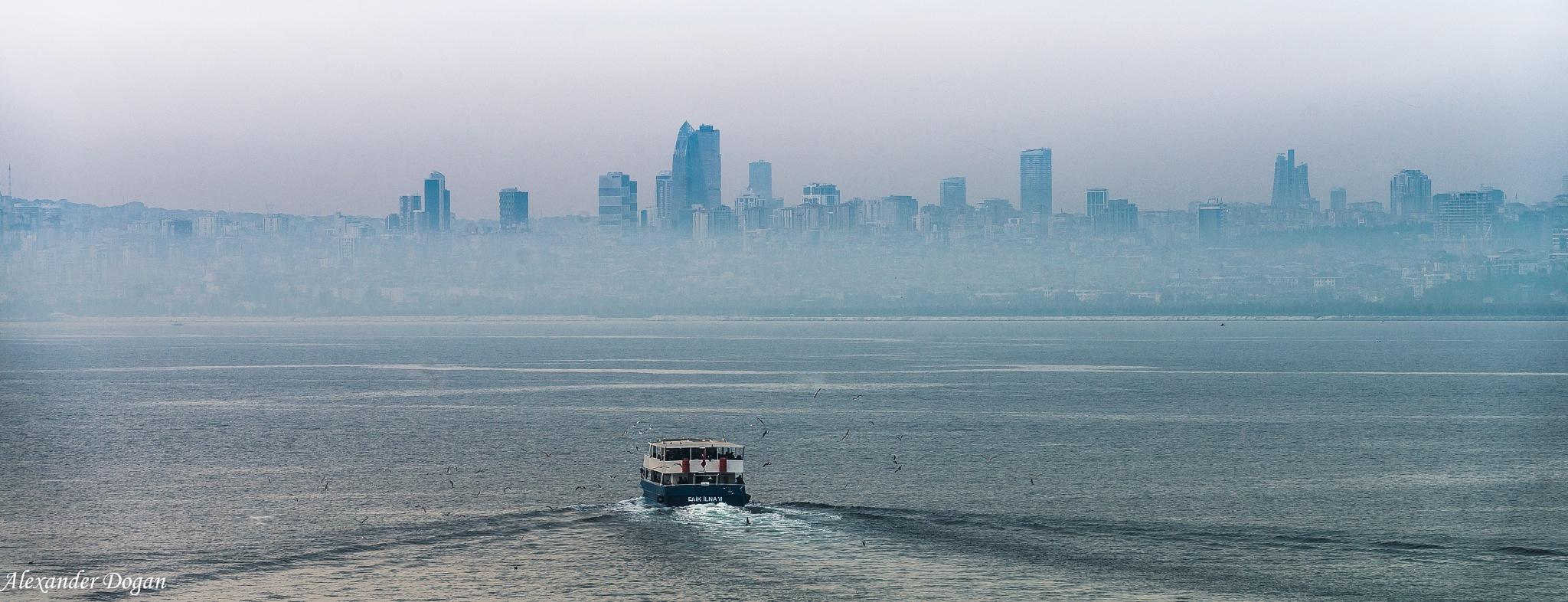 Fog over skyline of Istanbul. by Alexander Dogan