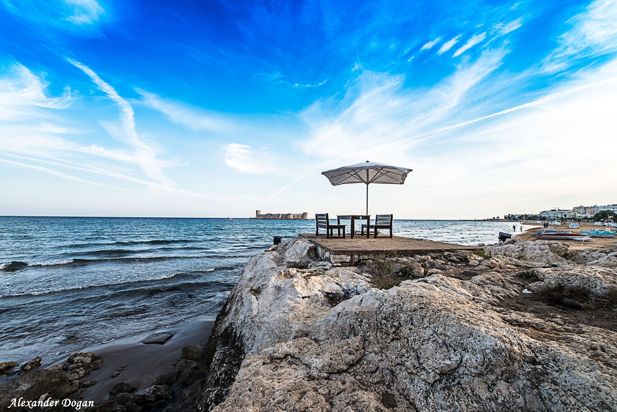 In the south of Turkey-Mersin, in the background the Historic Girl Castle.  by Alexander Dogan