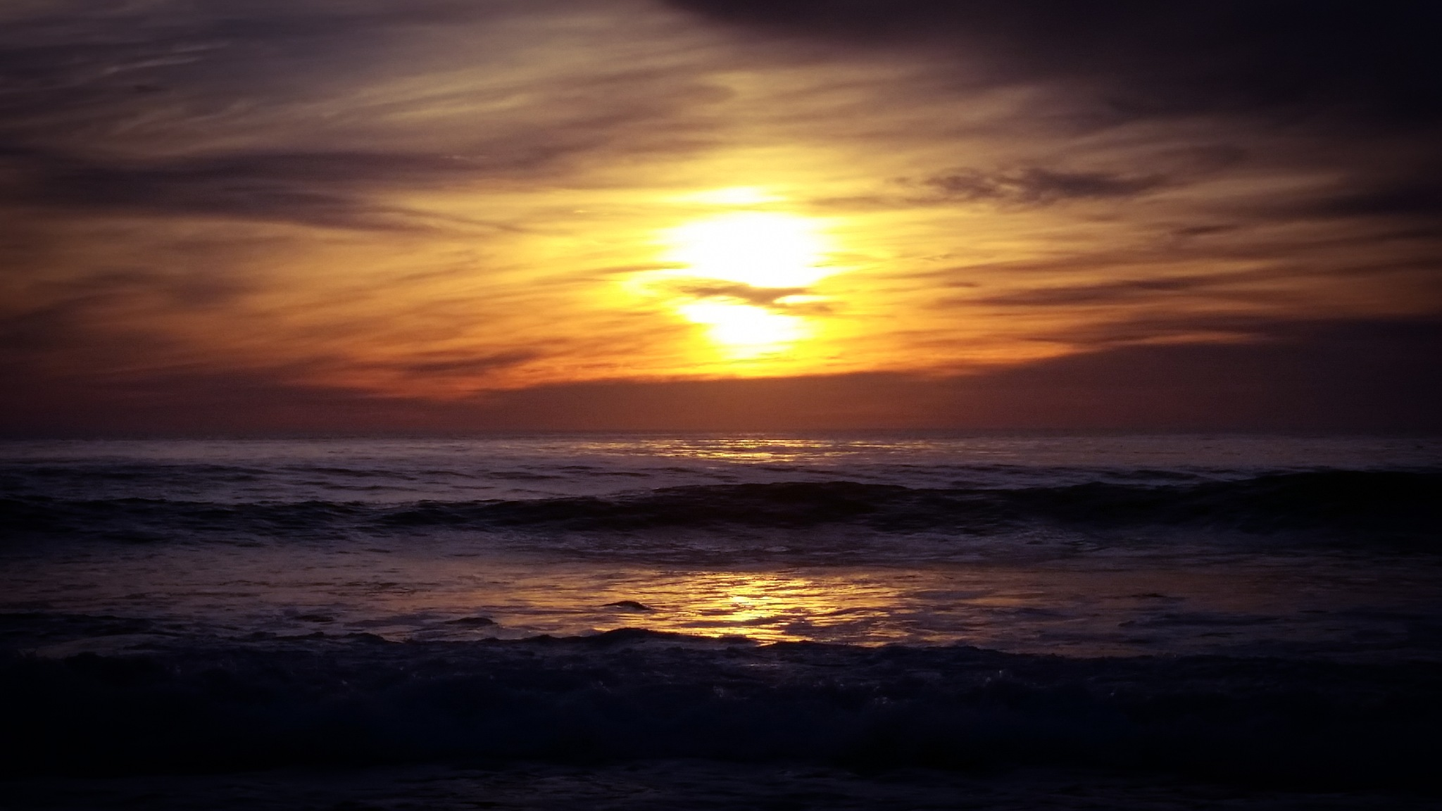 Sunset over the Pacific Ocean  by Ted Fletcher