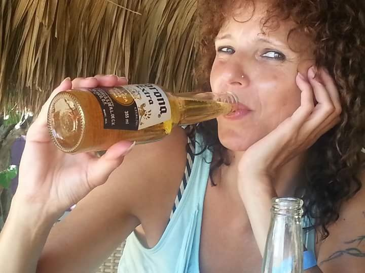 Drinking a cold Corona on Pirate Bay Curaçao  by Ilse Peters