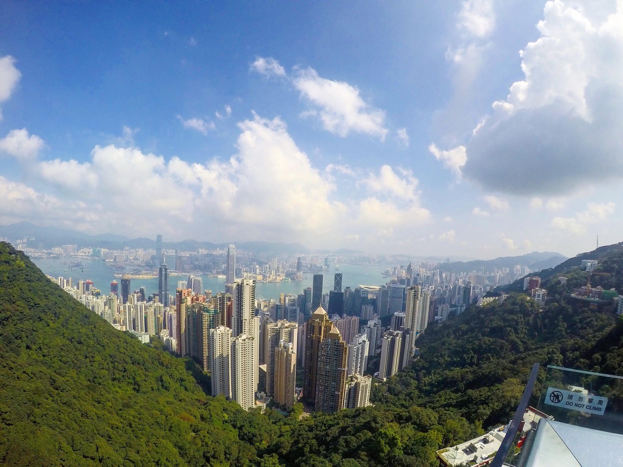 Hong Kong among the clouds by Lkjaye