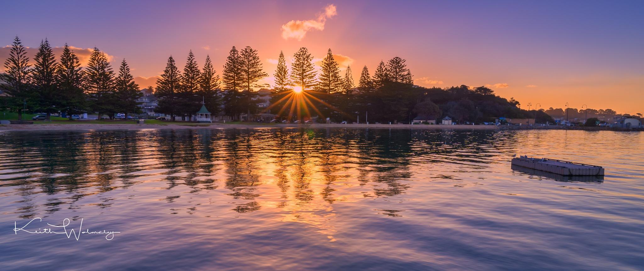 Sunset through the trees by keithhmw