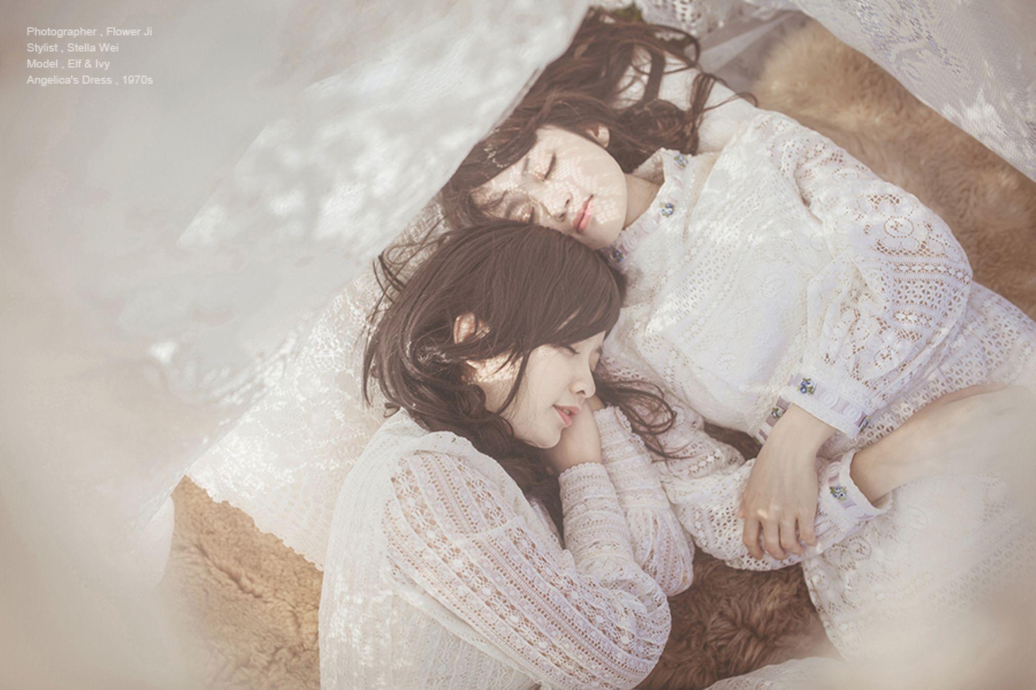 Two girls by Flower Ji