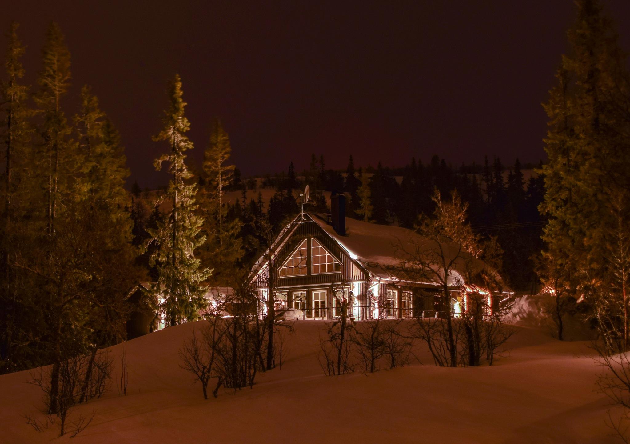 Cabin in winterscape by Pontus Schröder