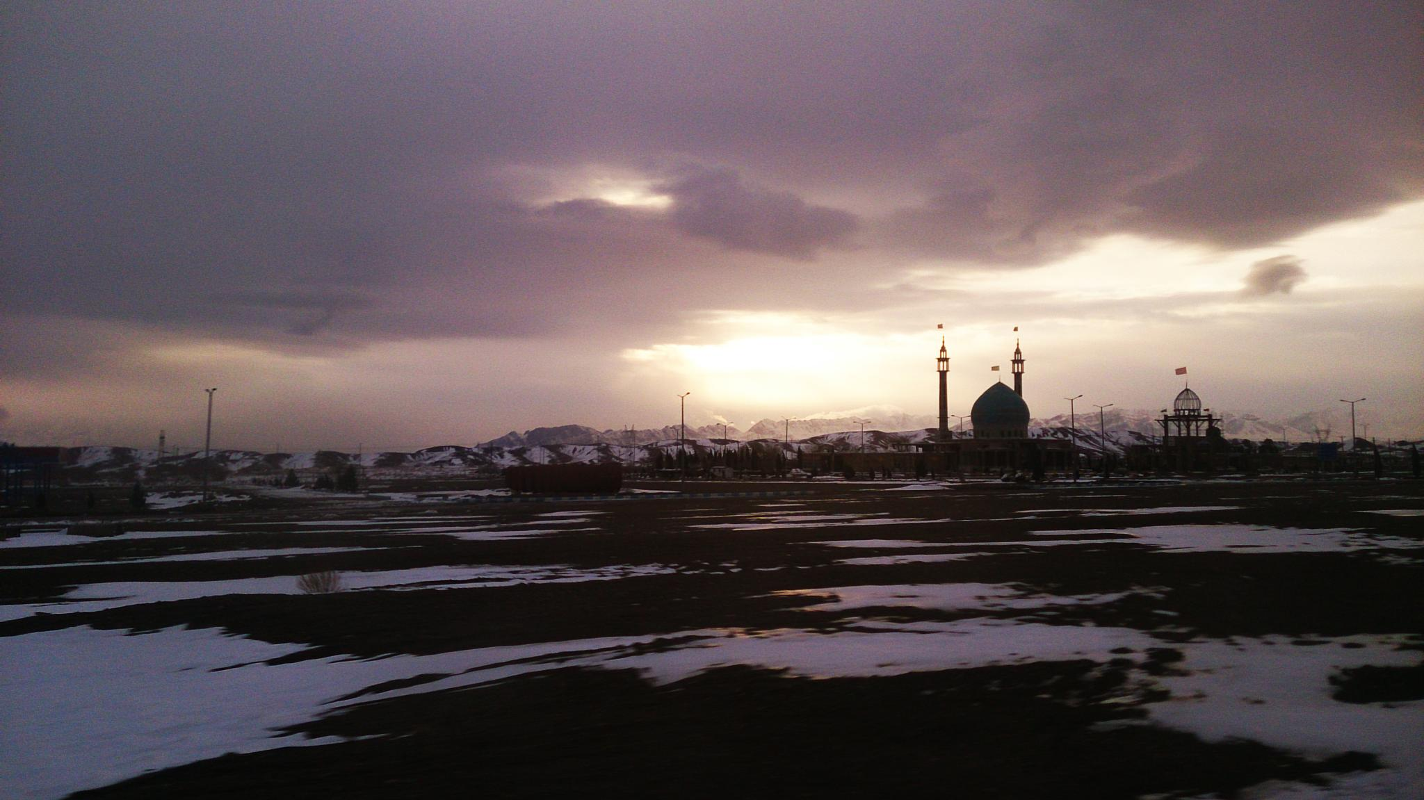 mosque among the snowy mountains by HEUER