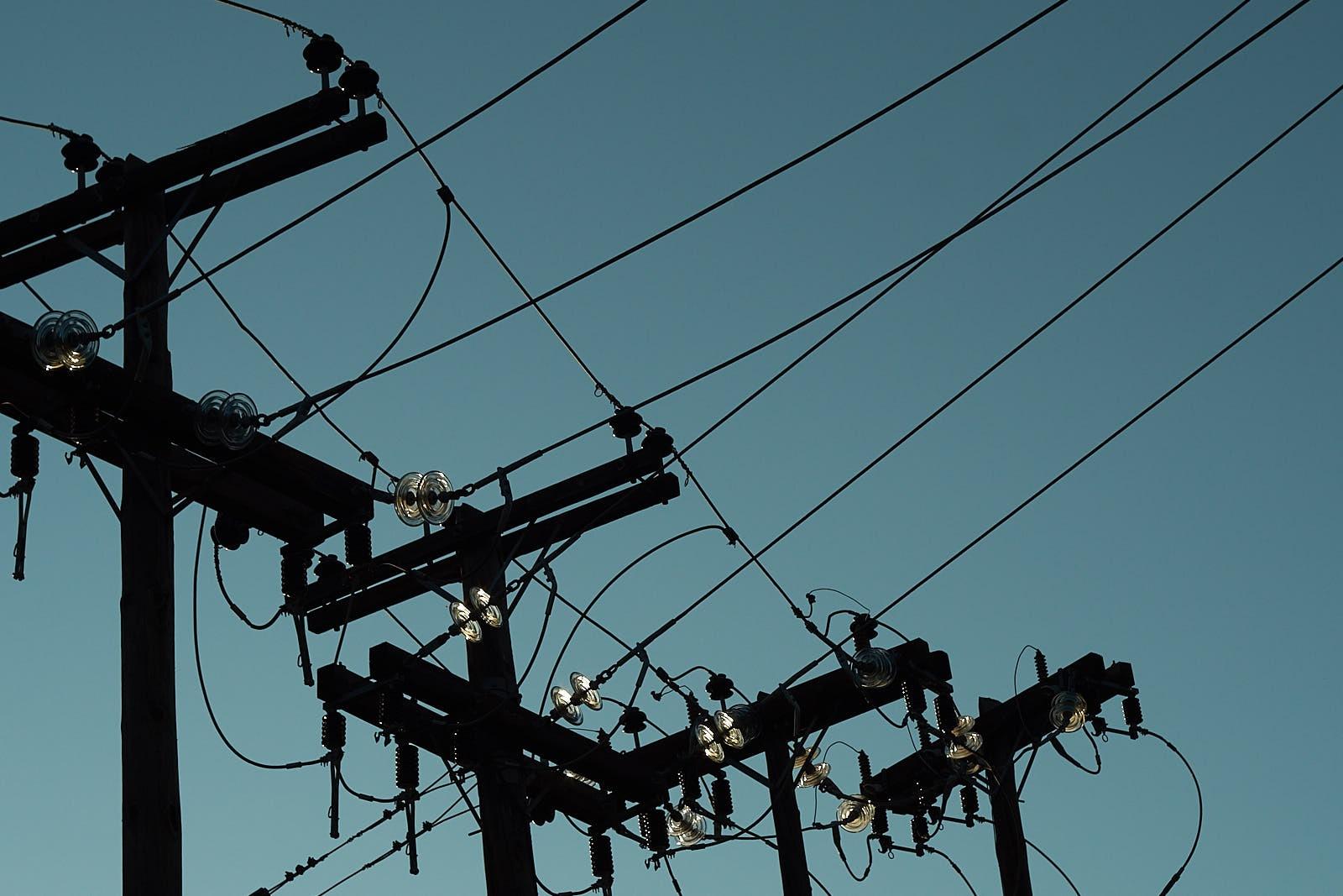 Power Poles at Dusk by Zoran Rilak