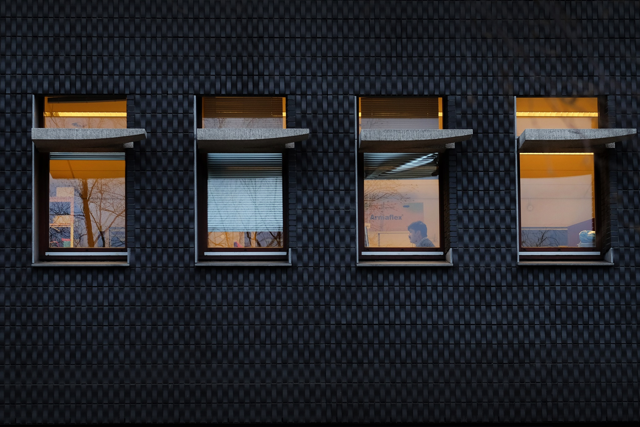 Four windows and an employee by Bram Busink