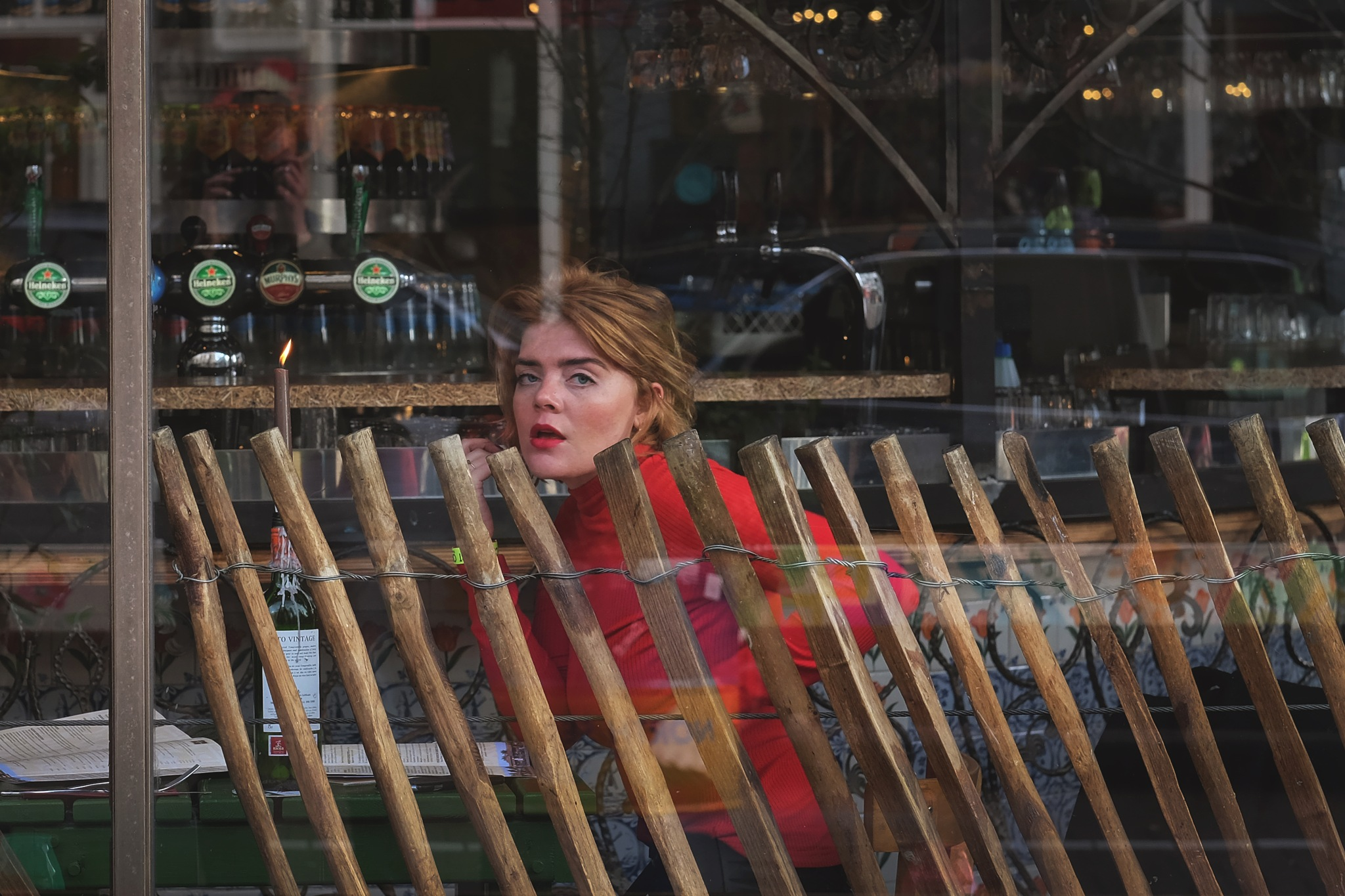 Photo in Random #streetphotography #street #street portrait #window #bar #people #red