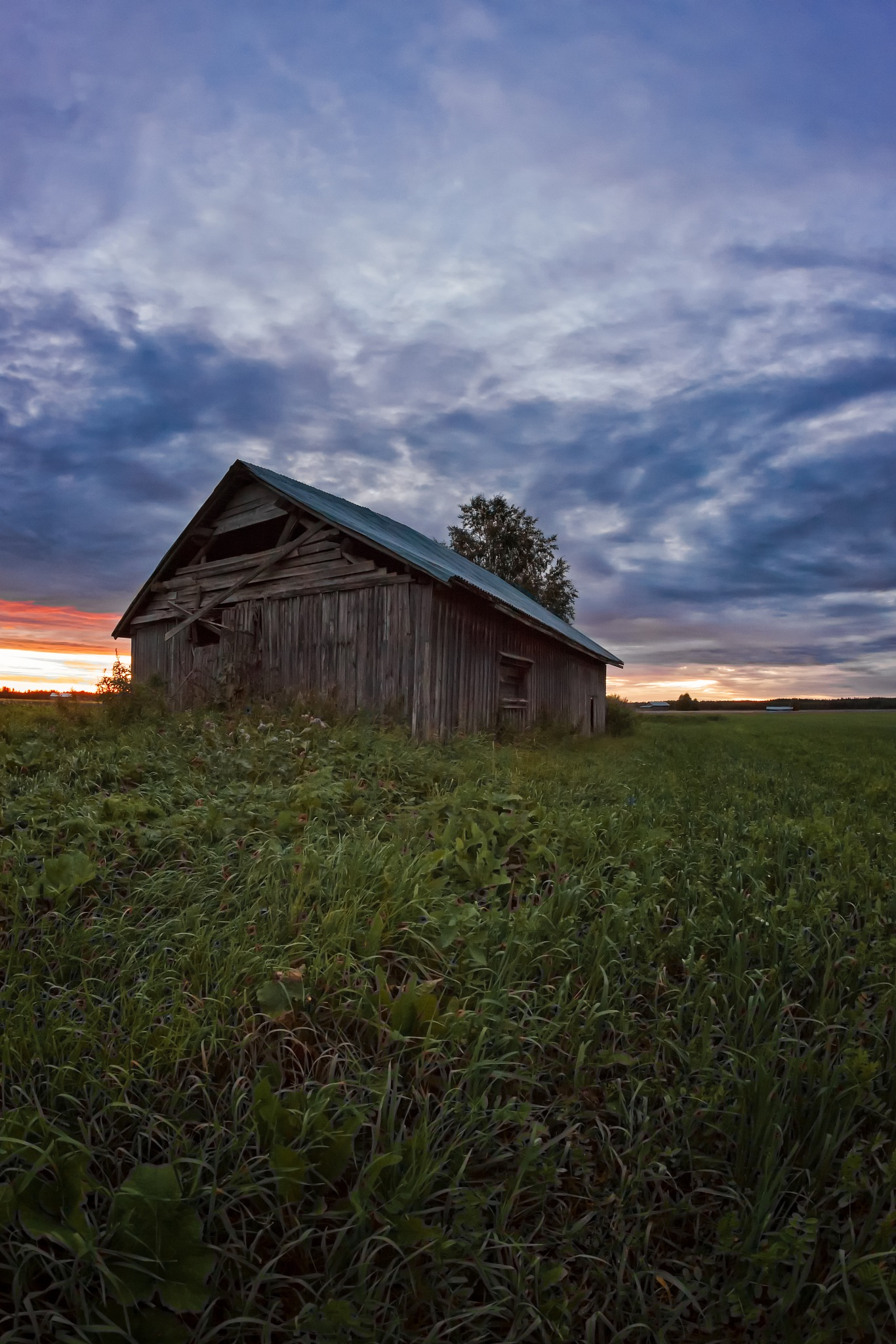 Sunset Clouds And An Old Barn House by J.P. Heinovirta