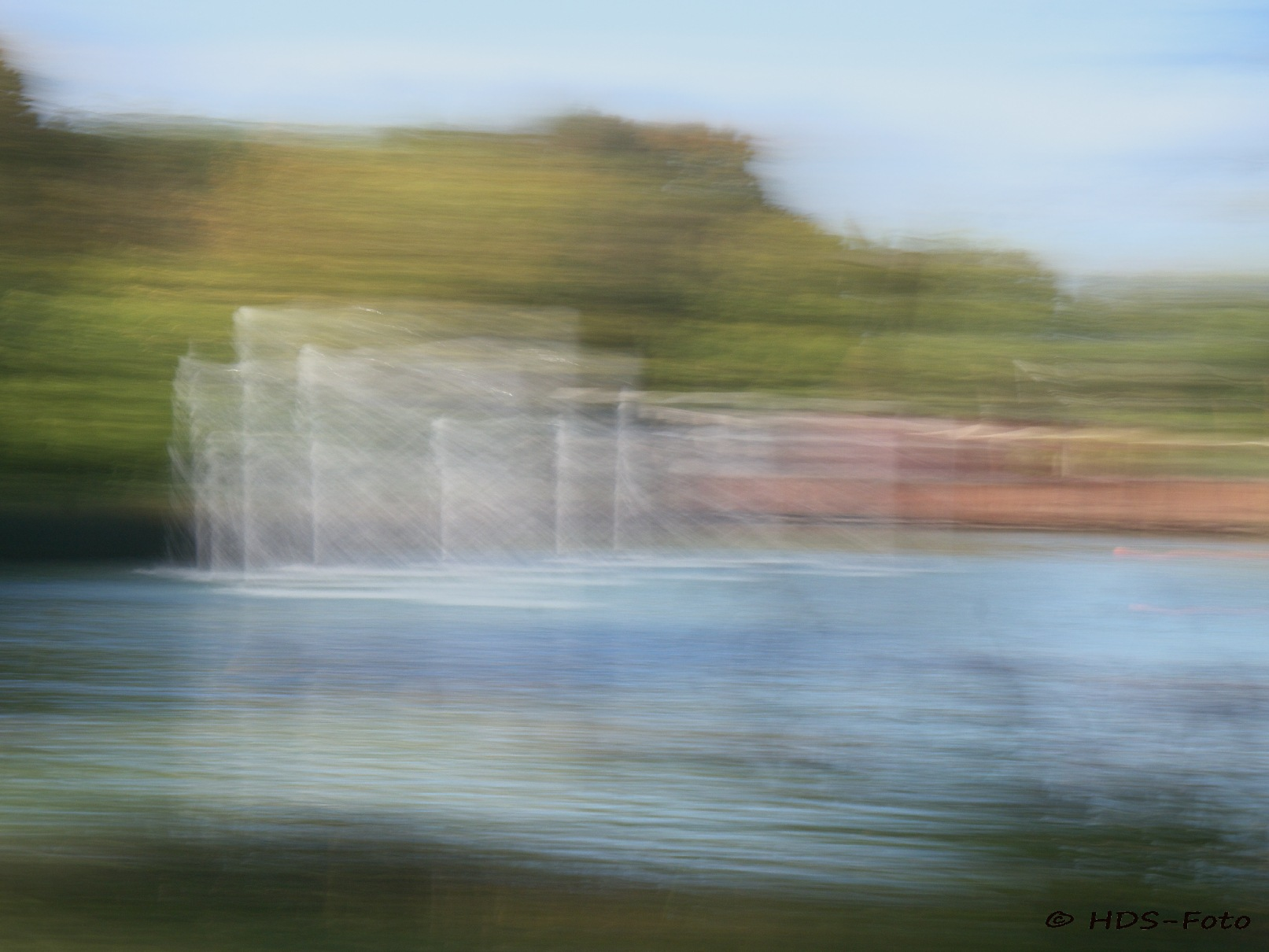 water fountains in a pond by Horst Schade