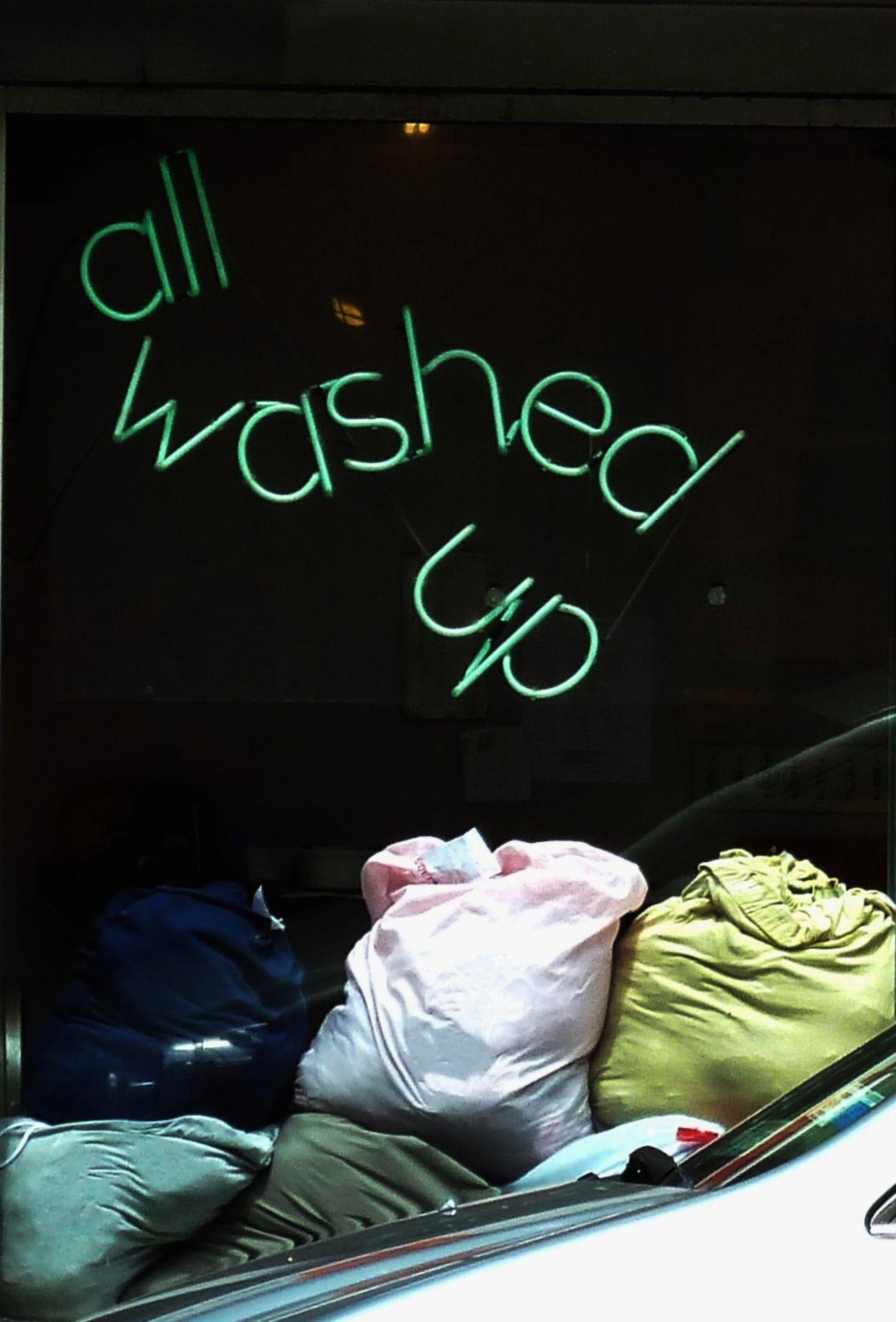Laundromat window, NYC by Anton Agalbato