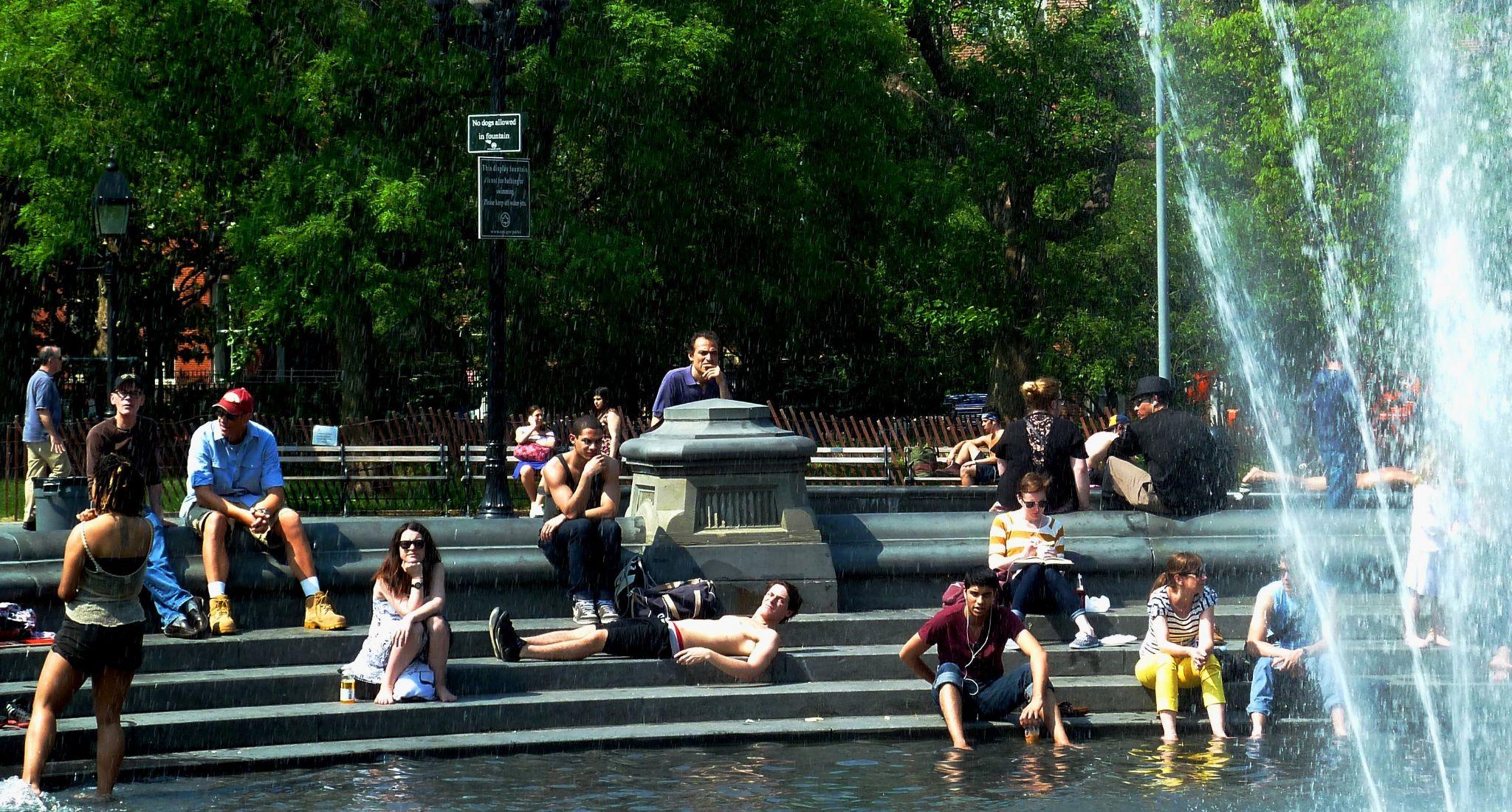 Around the fountain at Washington Sq. Park, Greenwich Village, NYC. by Anton Agalbato