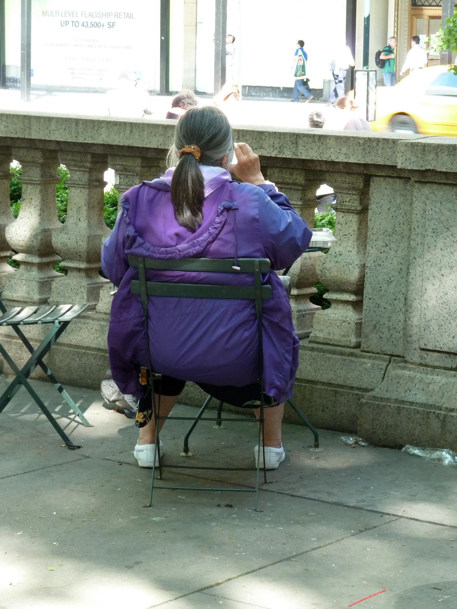 Tourist taking a break on a hot day in May. Bryant Park, NYC Public Library. by Anton Agalbato