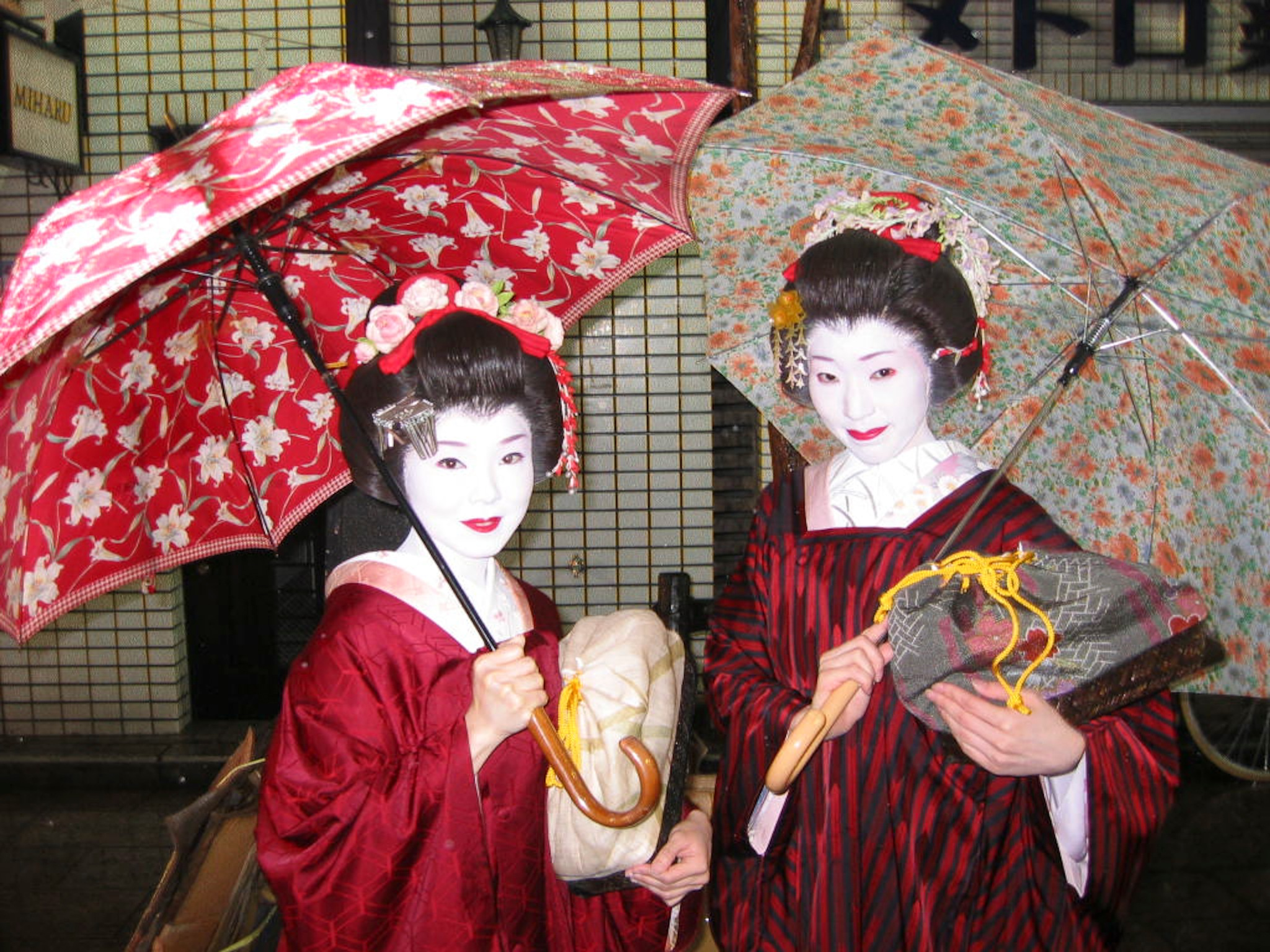 Geishas on a Tokyo Street at night by Miloliidrifter