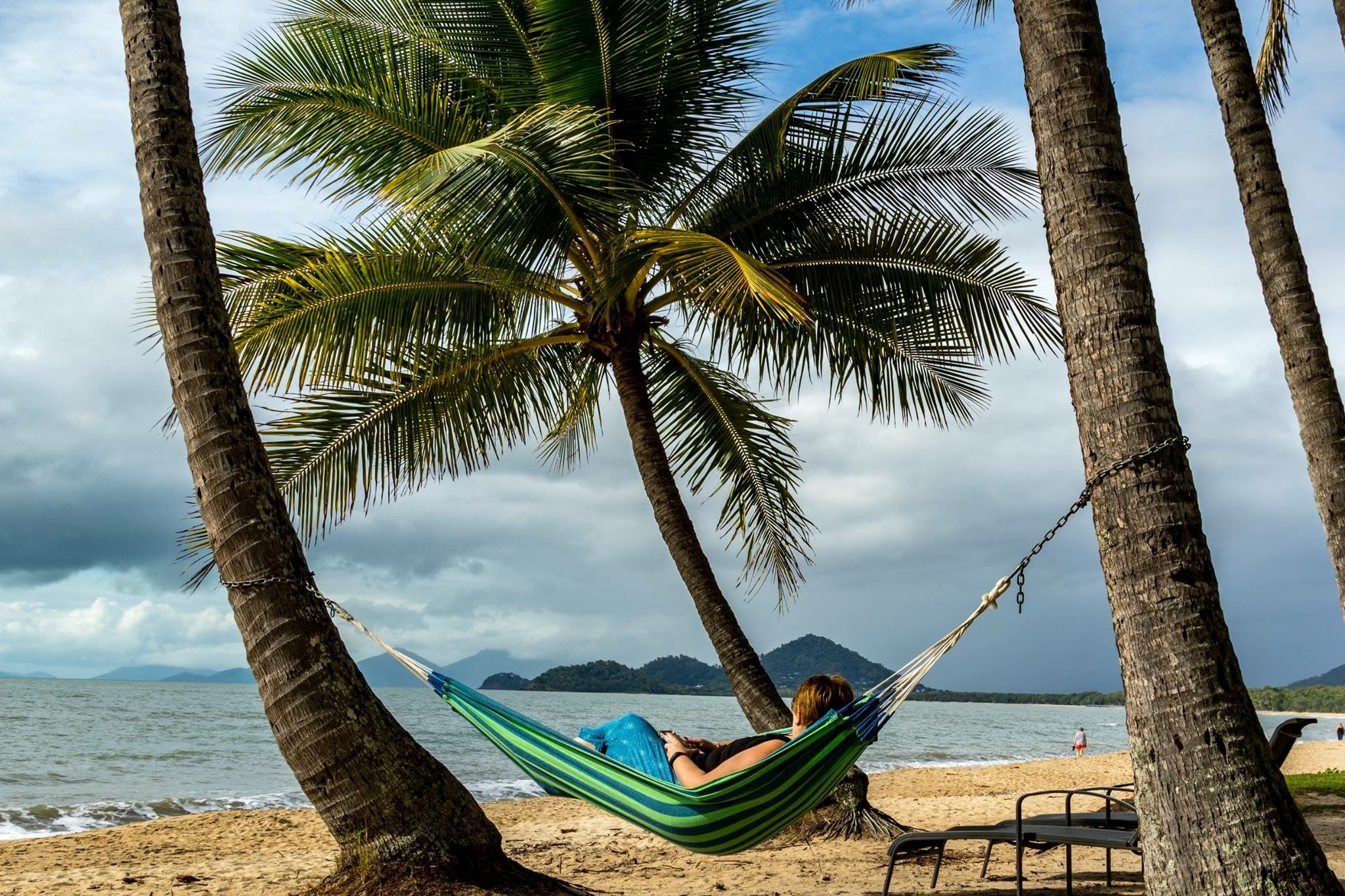 Woman in hammock between palm trees by jmimages