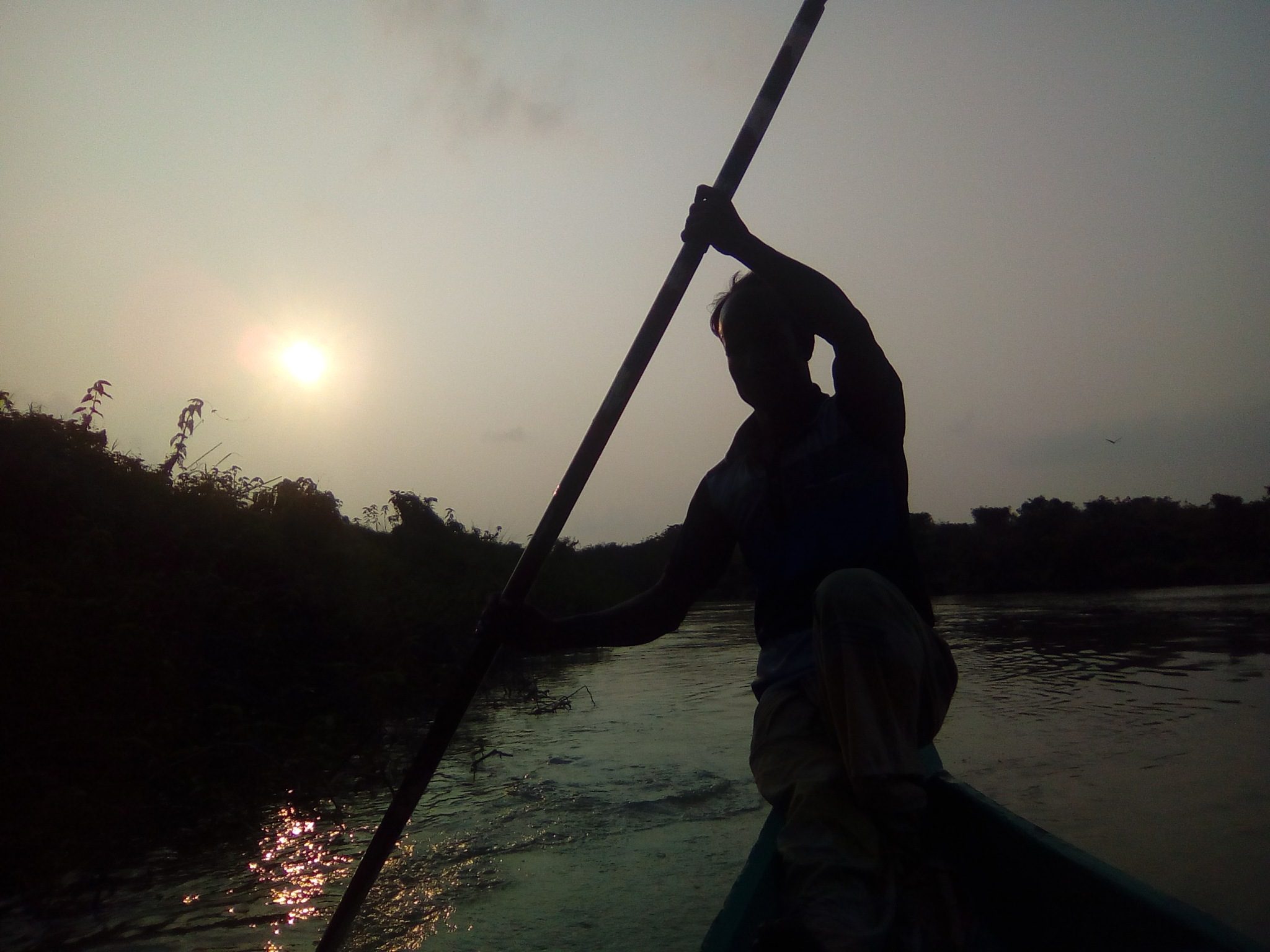 Boatman and evening time by Md Kamrul Islam
