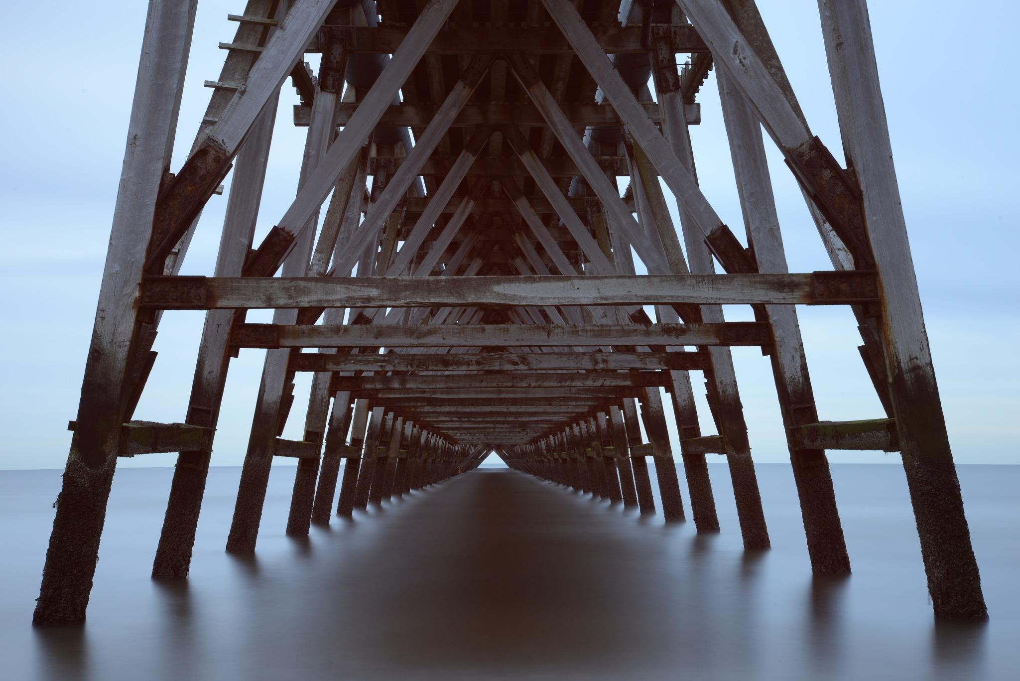 Under the pier by Neil Sheldon