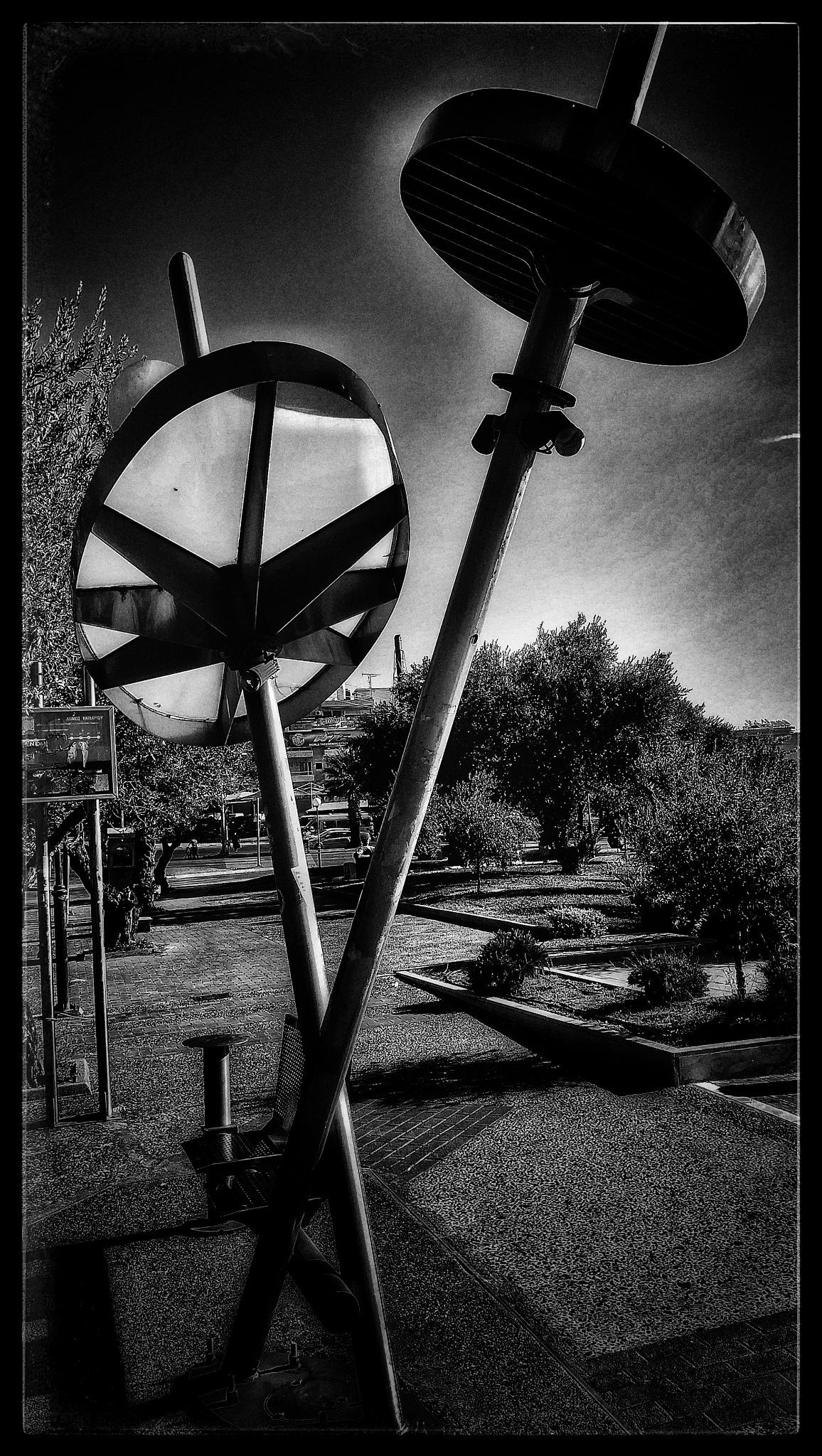 Round... by Nektarios Mpouterakos