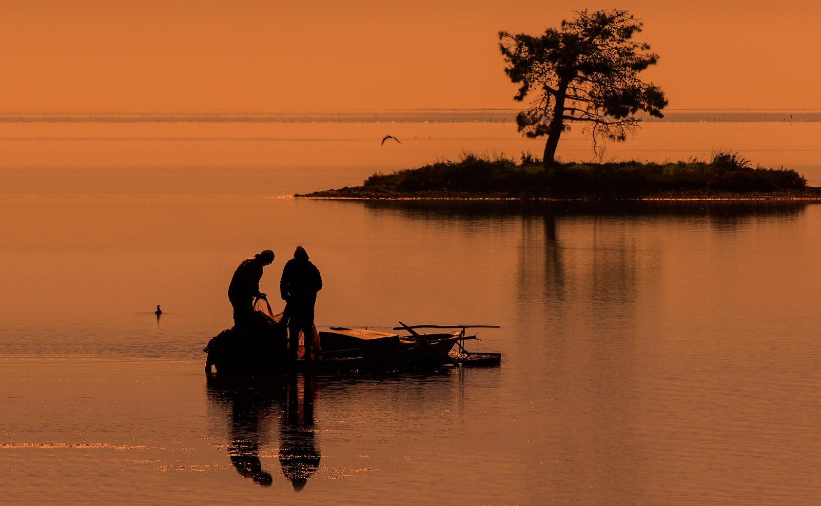 Throwing fishing Net!! by Sotiris Siomis
