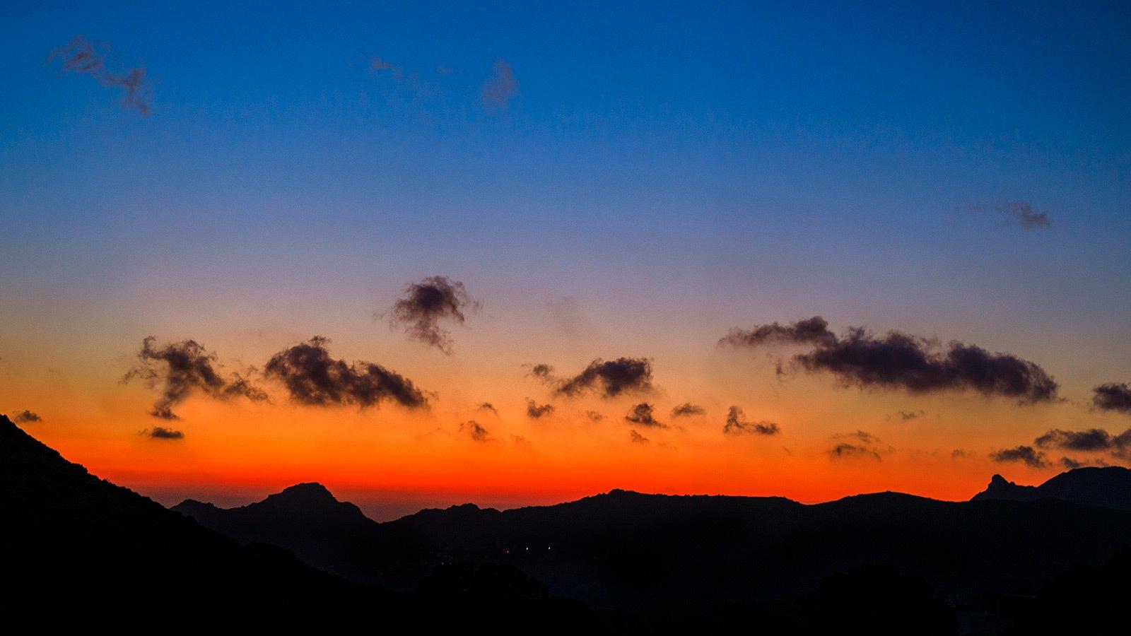 Sunset over the mountain near Filoti  by Sotiris Siomis