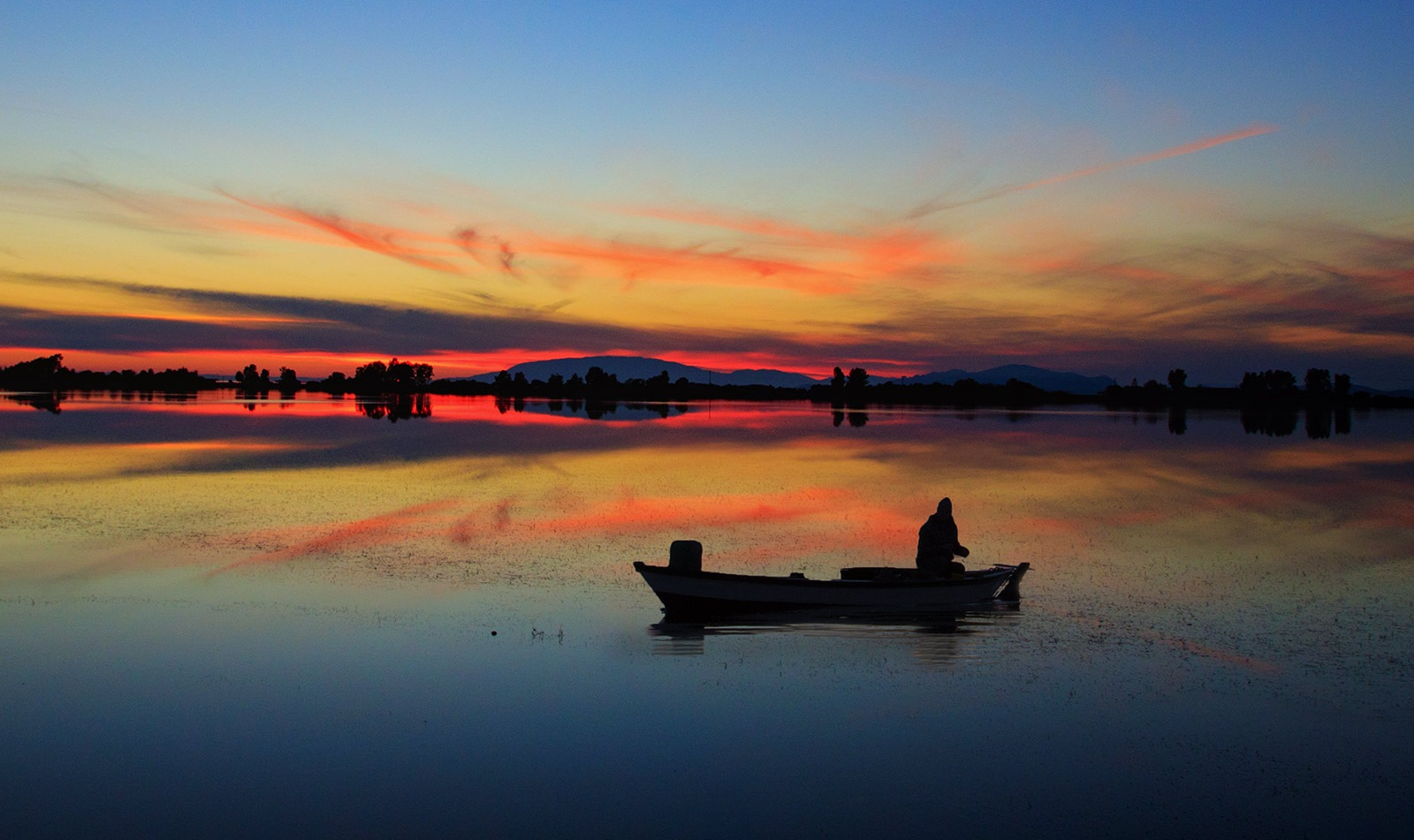 Throwing Fishing Net by Sotiris Siomis