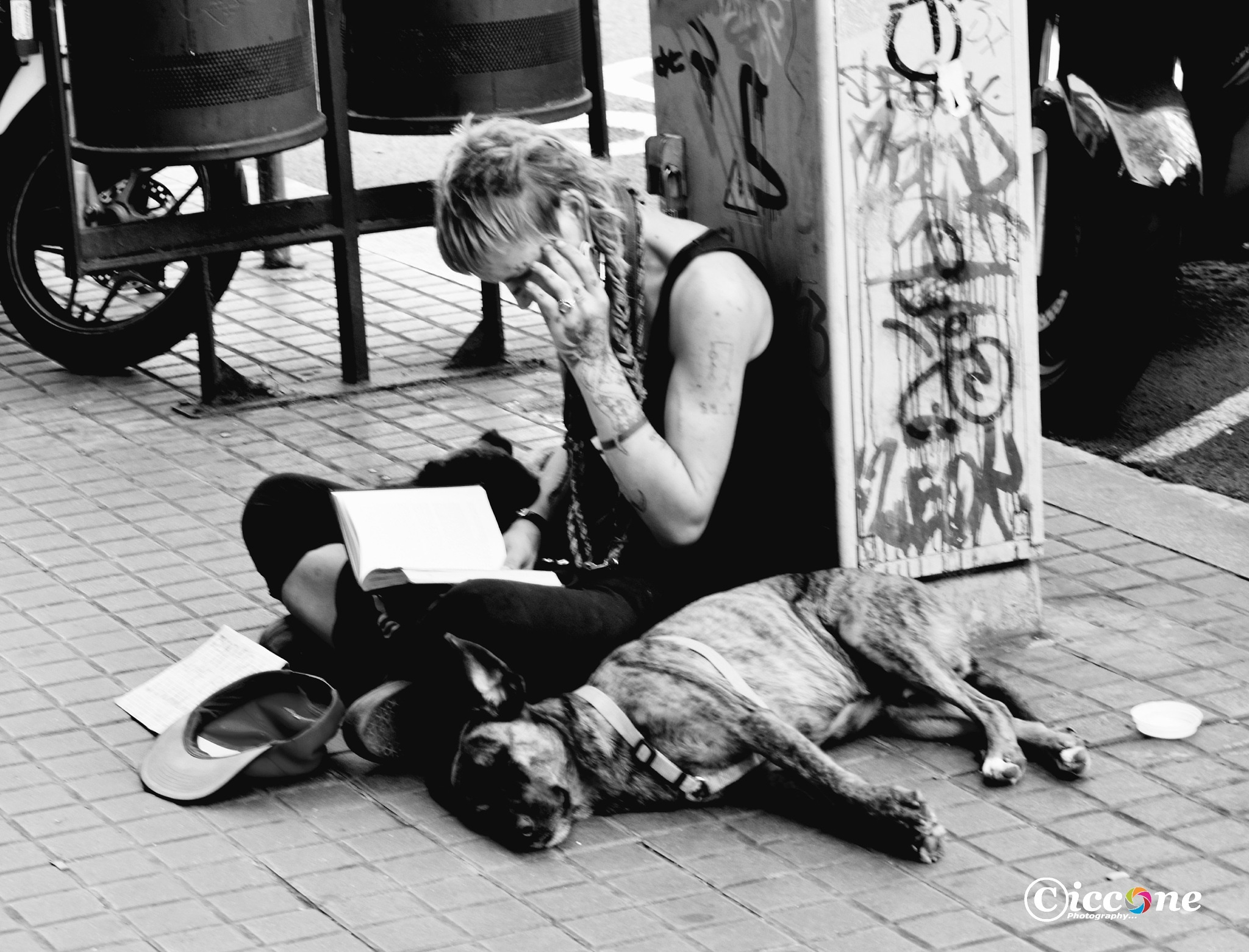Street Beggar in Barcelona by Marc Ciccone