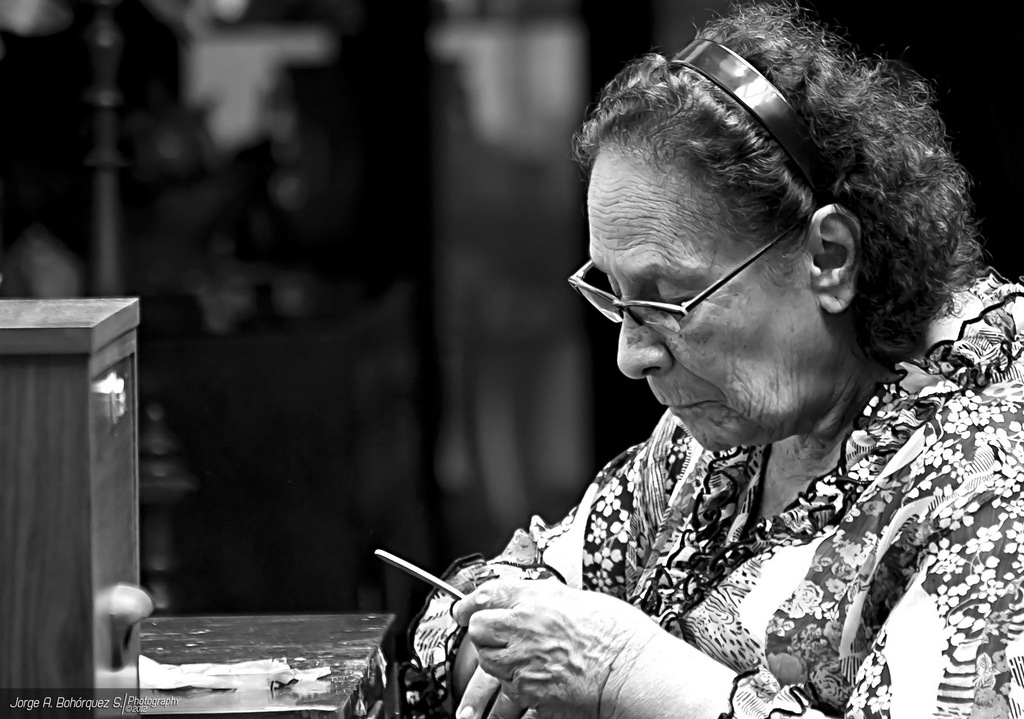 grandmother getting her nails done by Jorge A. Bohorquez S.